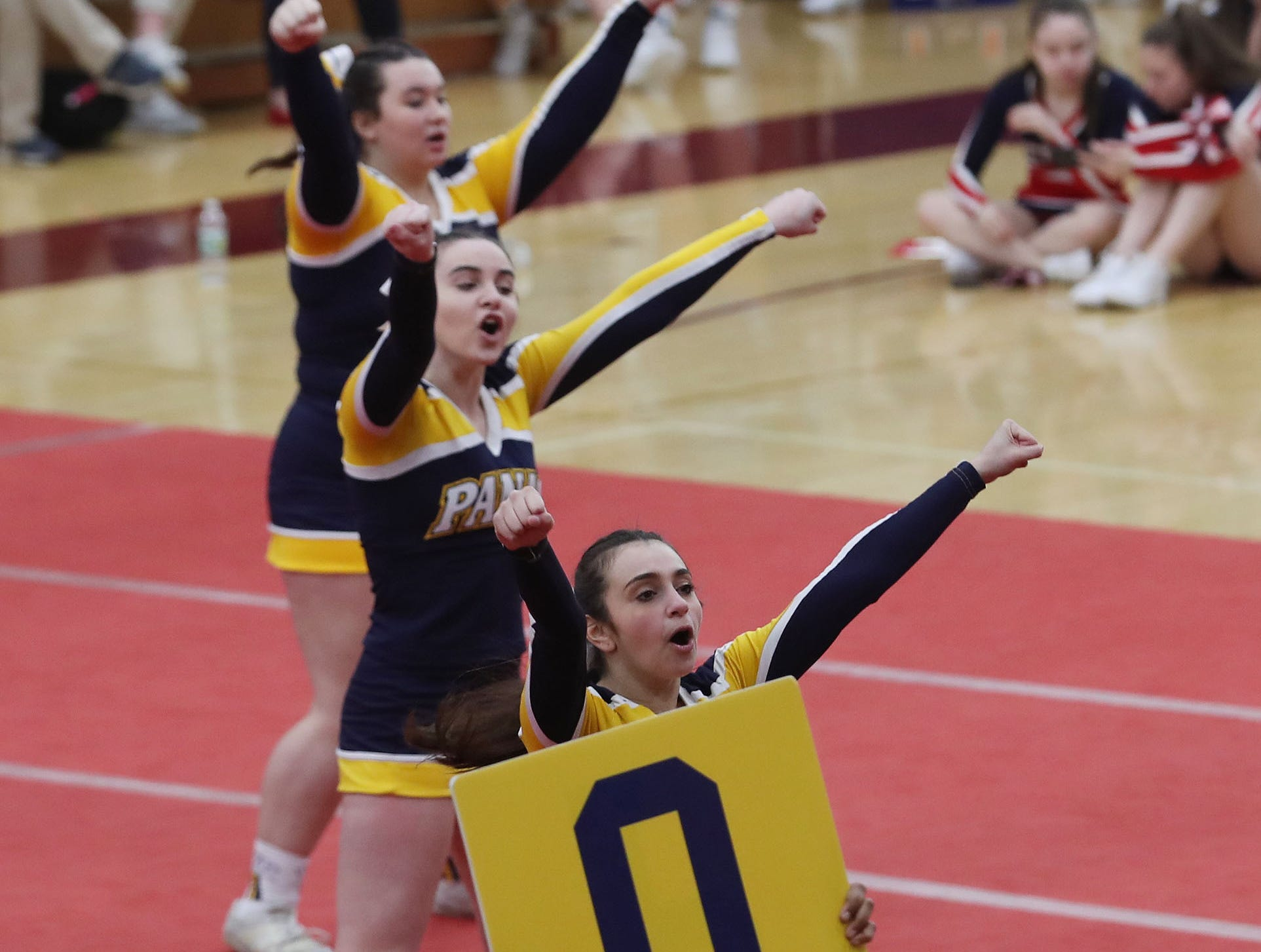 Walter Panas High School competes during the Section 1 cheerleading championships at Arlington High School in Freedom Plains Feb. 16, 2019.