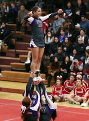 New Rochelle High School competes during the Section 1 cheerleading championships at Arlington High School in Freedom Plains on Feb. 16, 2019.