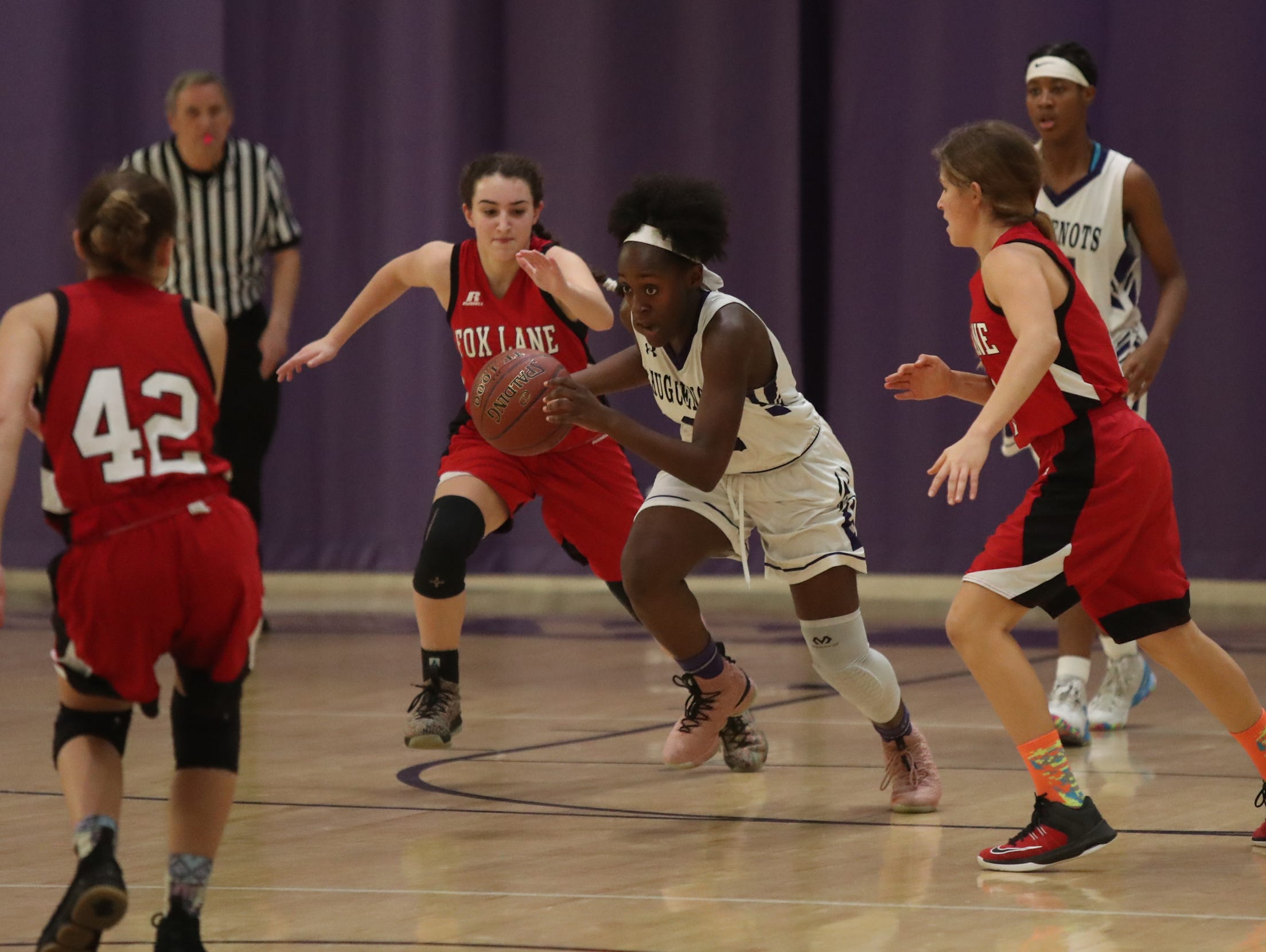 New Rochelle's Nia Bailey (2) pulls in a loose ball in the class AA girls basketball outbracket game against Fox Lane at New Rochelle High School in New Rochelle on Saturday, February 16, 2019.