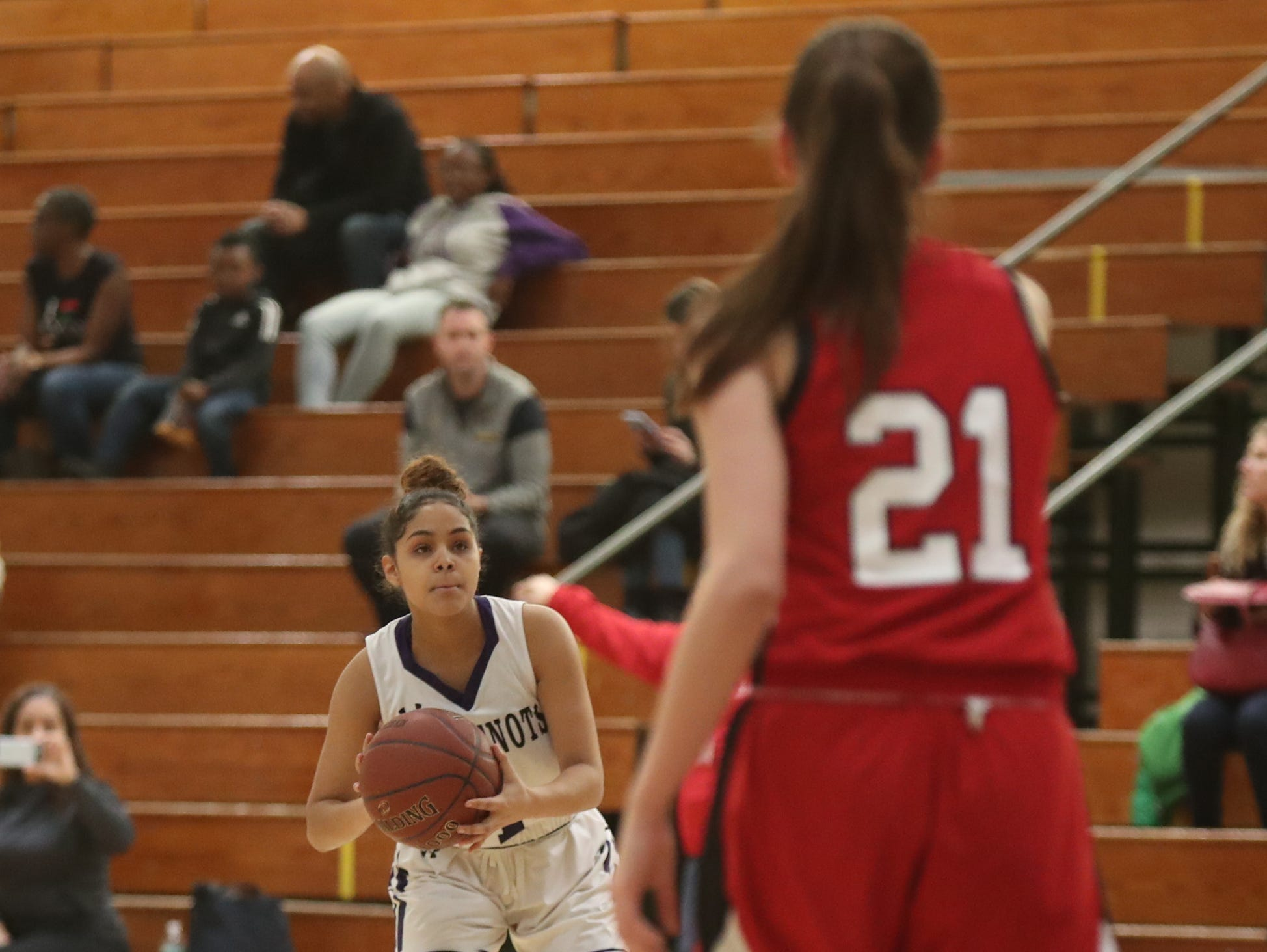 New Rochelle's Christina Rasposo (1) takes a shot from outside in the class AA girls basketball outbracket game against Fox Lane at New Rochelle High School in New Rochelle on Saturday, February 16, 2019.