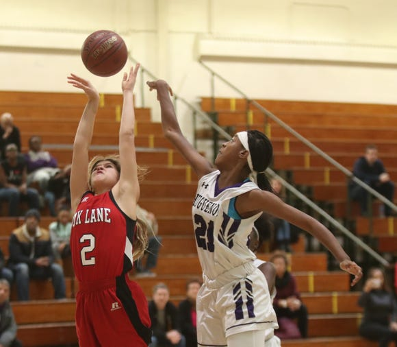 New Rochelle's Nyeira Spady (21) blocks a shot by Fox Lane's Clarissa Landsman (2) in the class AA girls basketball outbracket game at New Rochelle High School in New Rochelle on Saturday, February 16, 2019.