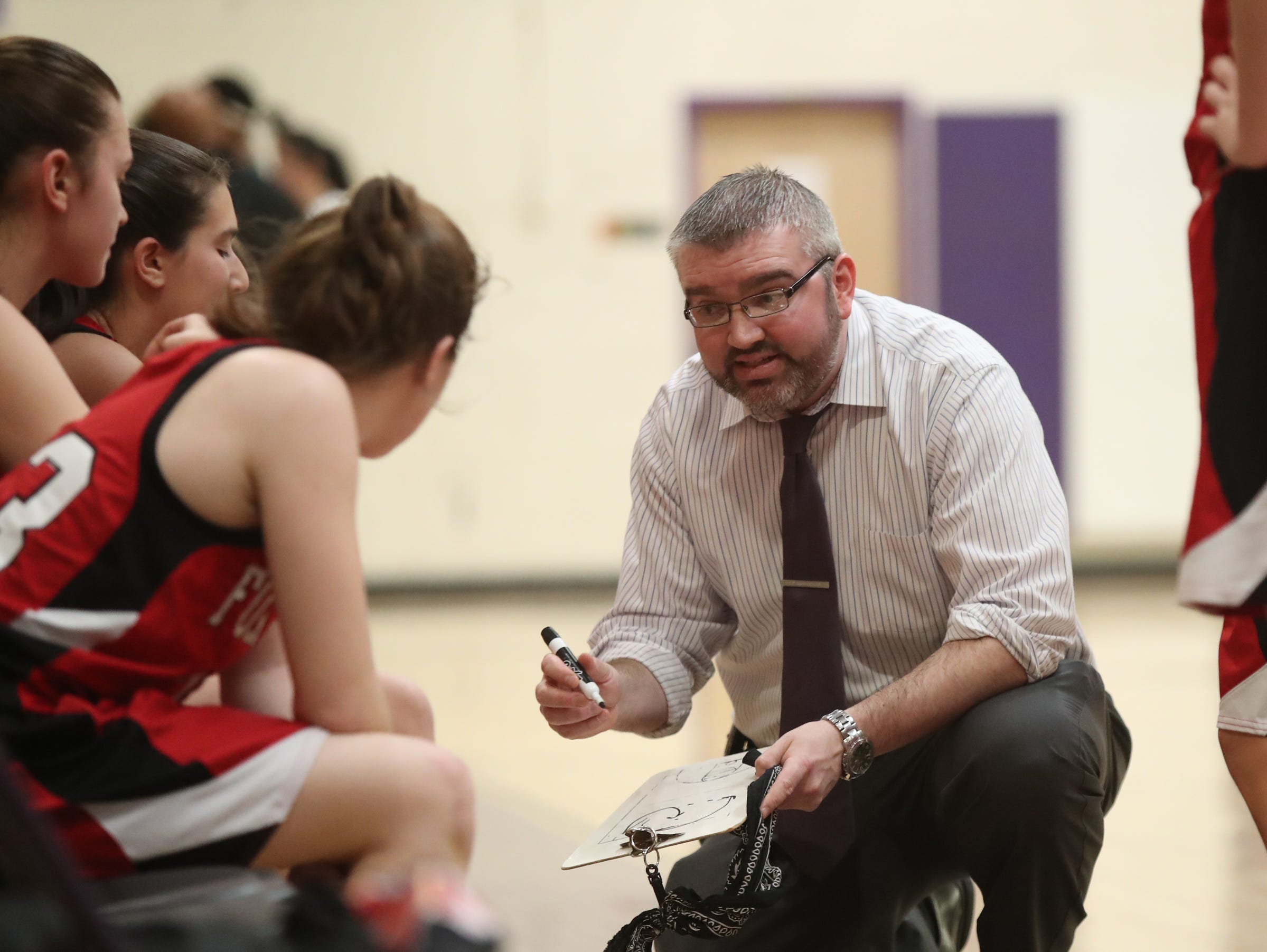 Fox Lane head coach Kriss Matts goes over a play during a time-out in the class AA girls basketball outbracket game against New Rochelle at New Rochelle High School in New Rochelle on Saturday, February 16, 2019.