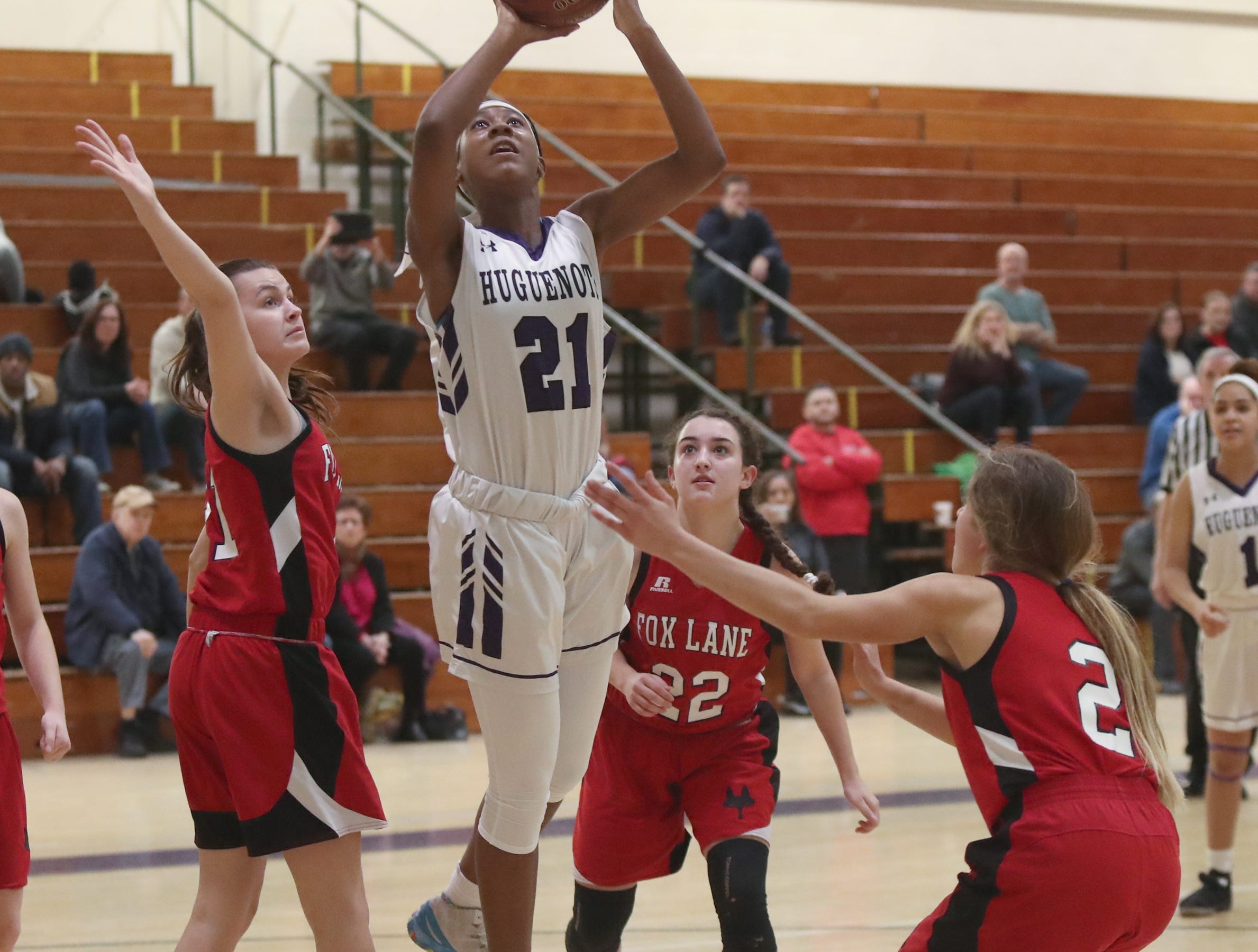 New Rochelle's Nyeira Spady (21) puts up a shot in the class AA girls basketball outbracket game against Fox Lane at New Rochelle High School in New Rochelle on Saturday, February 16, 2019.