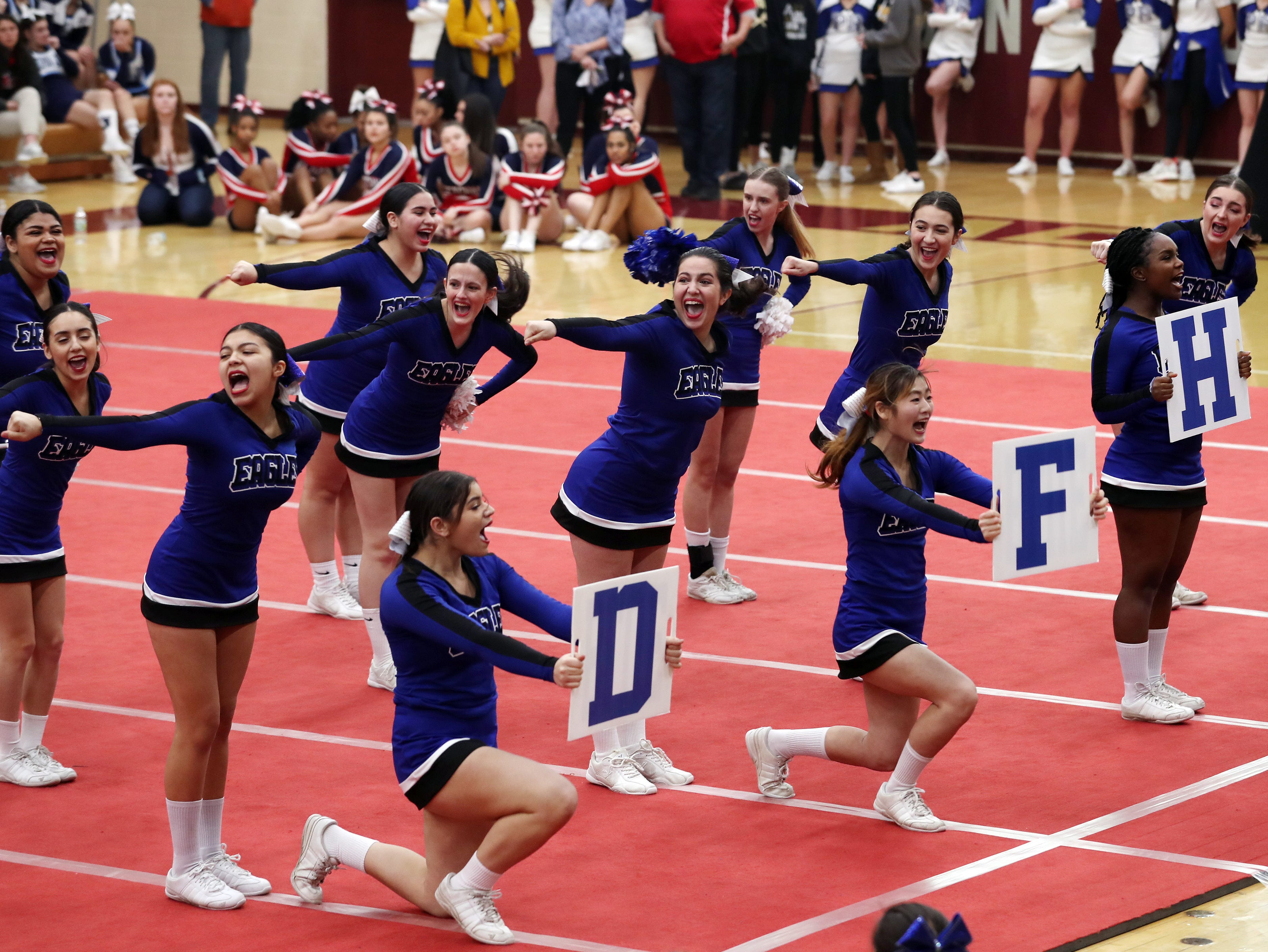 Dobbs Ferry High School competes during the Section 1 cheerleading championships at Arlington High School in Freedom Plains Feb. 16, 2019.