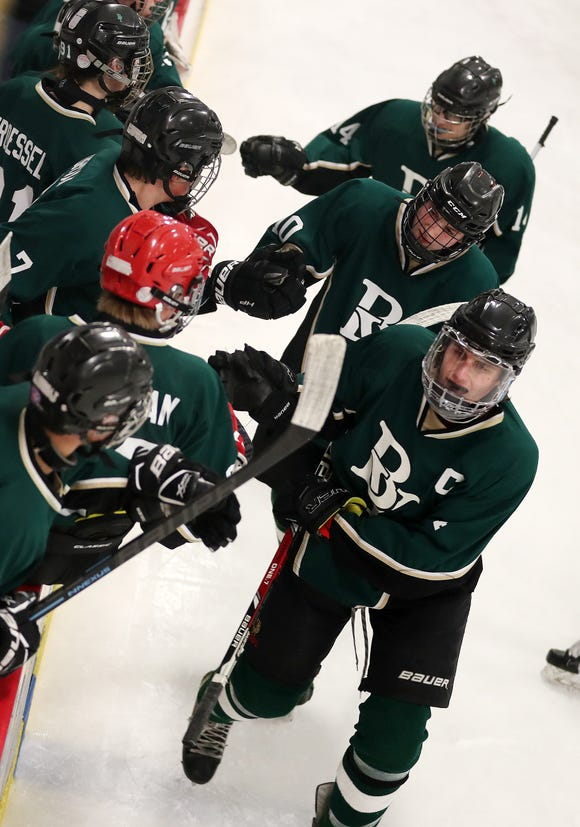 Brewster/Yorktown's Thomas Mark is congratulated by teammates after his goal against White Plains during playoff hockey action at the Brewster Sports Arena Feb. 15,  2019. Brewster/Yorktown won the game 4-1.