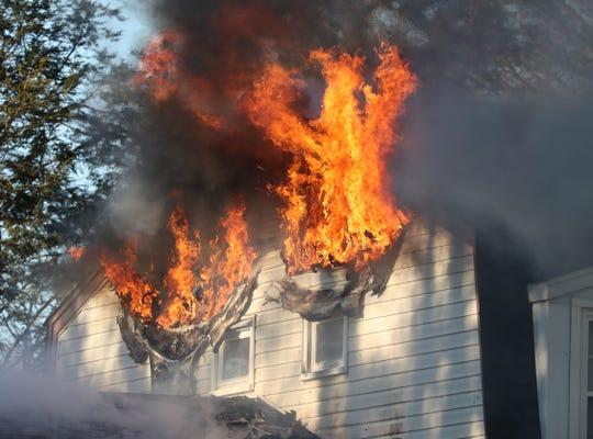Fire burns through the side of a house on Glynn Oval in Blauvelt Feb. 16, 2019.