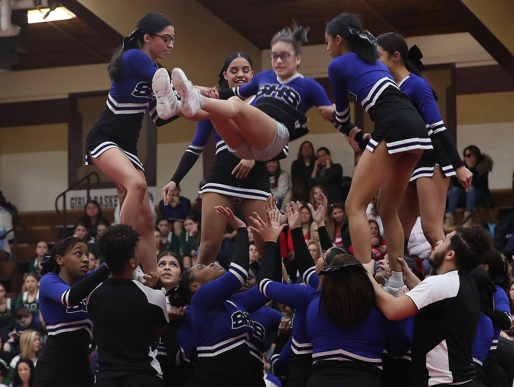 Saunders High School competes during the Section 1 cheerleading championships at Arlington High School in Freedom Plains Feb. 16, 2019.