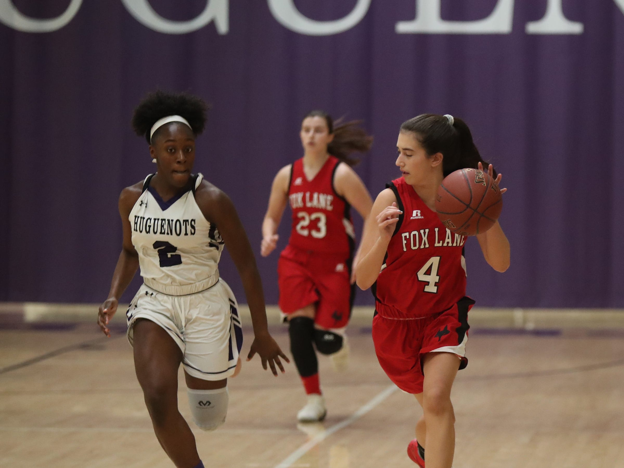 New Rochelle's Nia Bailey (2) chases down Fox Lane's Holly Ades (4) in the first half of the class AA girls basketball outbracket game at New Rochelle High School in New Rochelle on Saturday, February 16, 2019.