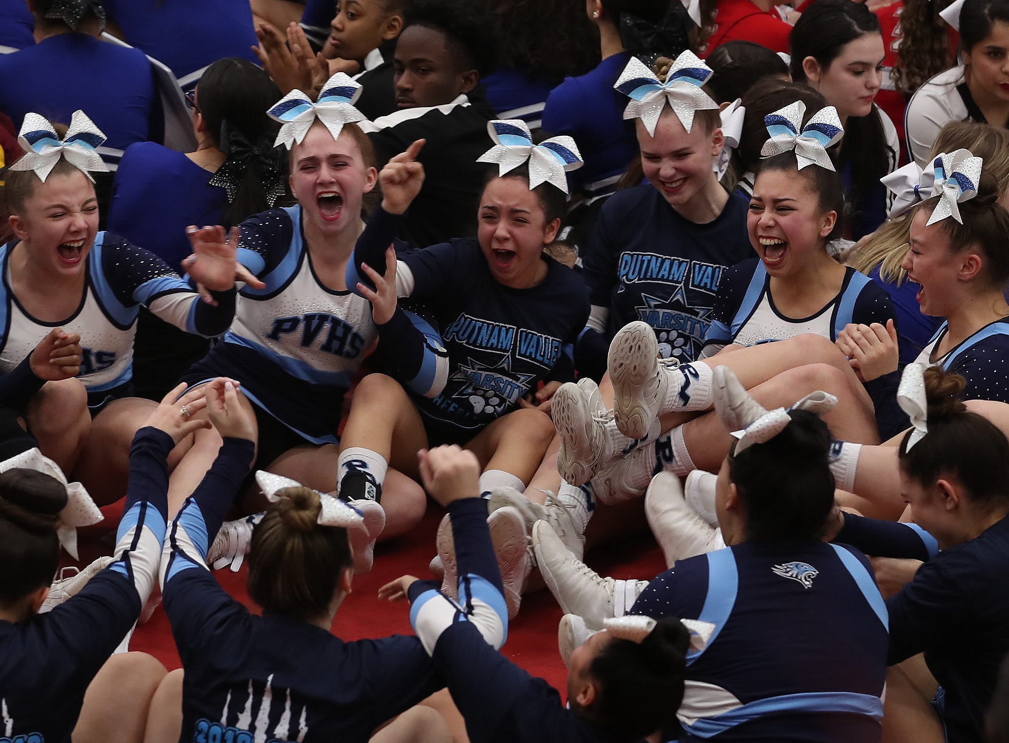 Putnam Valley cheerleaders react after learning they came in first place in their division during the Section 1 cheerleading championships at Arlington High School in Freedom Plains Feb. 16, 2019.