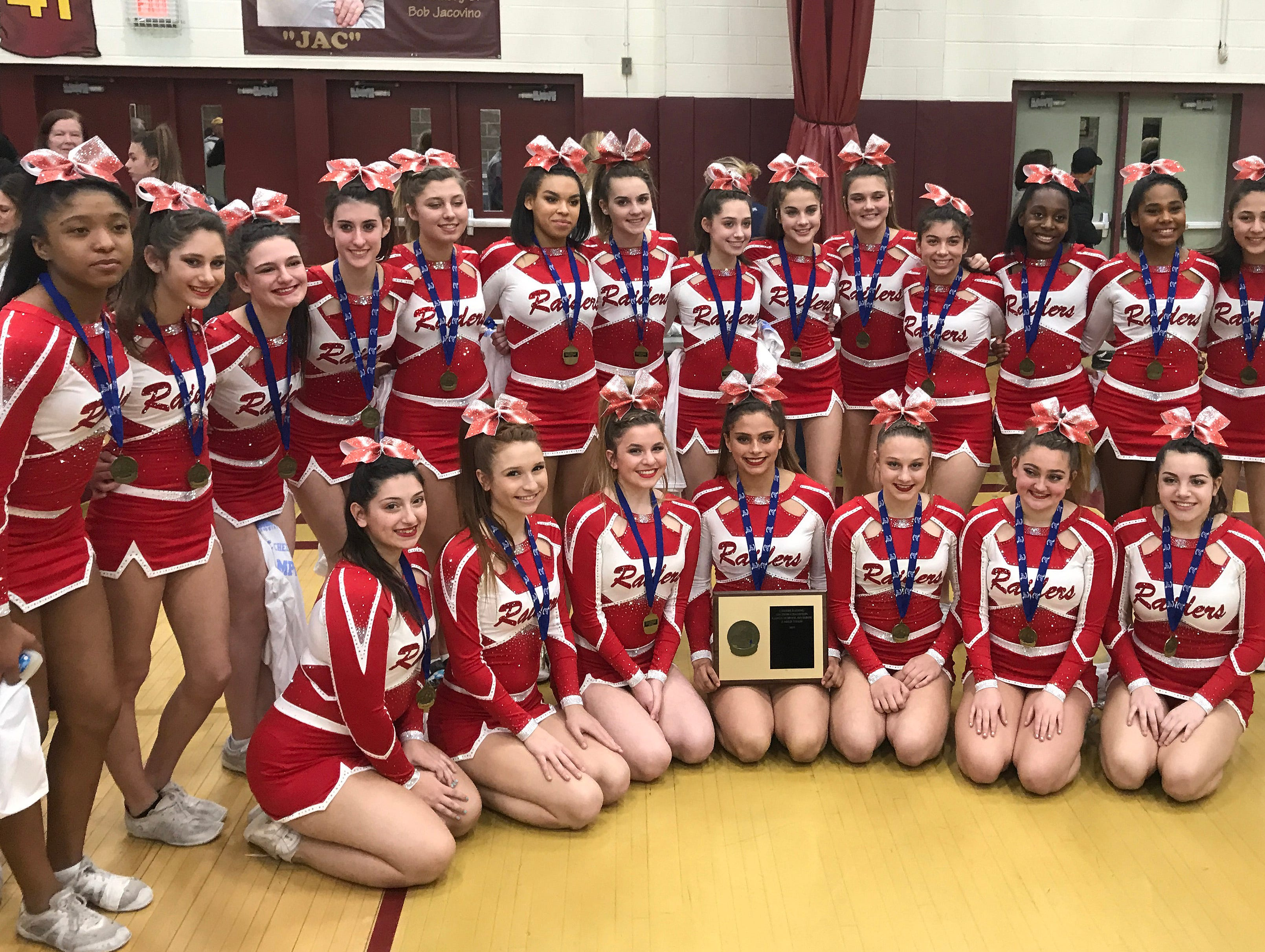 North Rockland cheerleaders pose with their championship plaque after they came in first place in their division during the Section 1 cheerleading championships at Arlington High School in Freedom Plains Feb. 16, 2019.