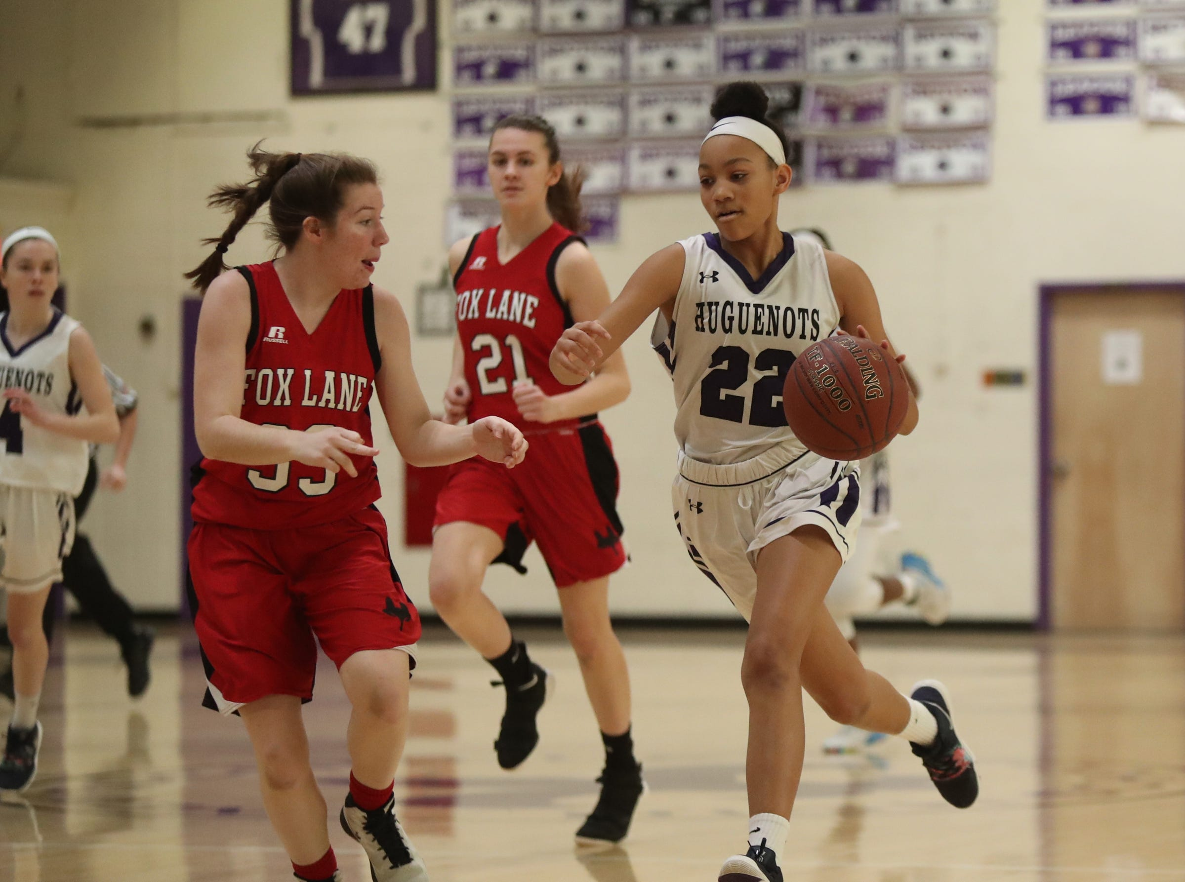 Fox Lane's Suzy Paul (33) defends New Rochelle's Kamara St. Paul (22) as she dribbles up court in the class AA girls basketball outbracket game at New Rochelle High School in New Rochelle on Saturday, February 16, 2019.