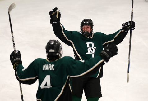 From left, Brewster/Yorktown's Thomas Mark and Sava Makarenko celebrate Mark's goal against White Plains during playoff hockey action at the Brewster Ice Arena Feb. 15,  2019. Brewster/Yorktown won the game 4-1.