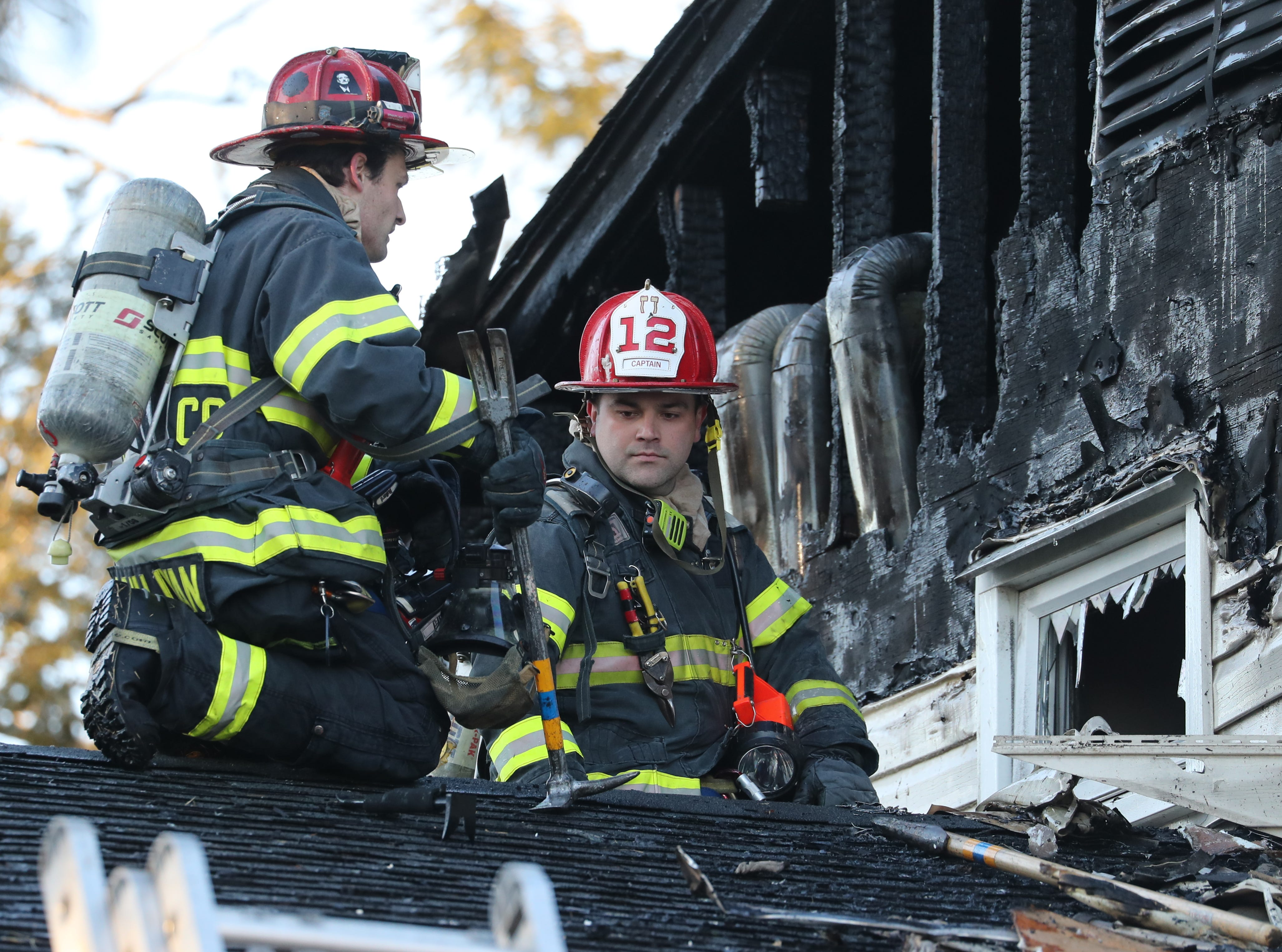 Firefighters work on the roof of a Glynn Oval house in Blauvelt Feb. 16, 2019. Several departments responded to the fire.