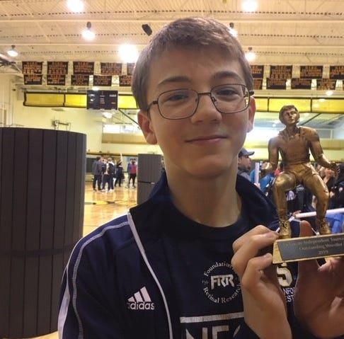 Just in 8th grade, Sanford's Griffith unbeaten and Outstanding Wrestler at Indy meet