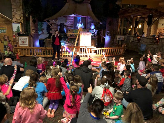Families and guests at Great Wolf Lodge in Grapevine participate in an evening storytime in the Grand Lobby.