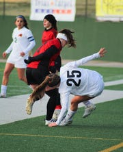 Old High Freshman Lucy Hood battles for the ball against Aledo's Megan Crawford. Aledo defeated Old High 3-1 at Memorial Stadium.