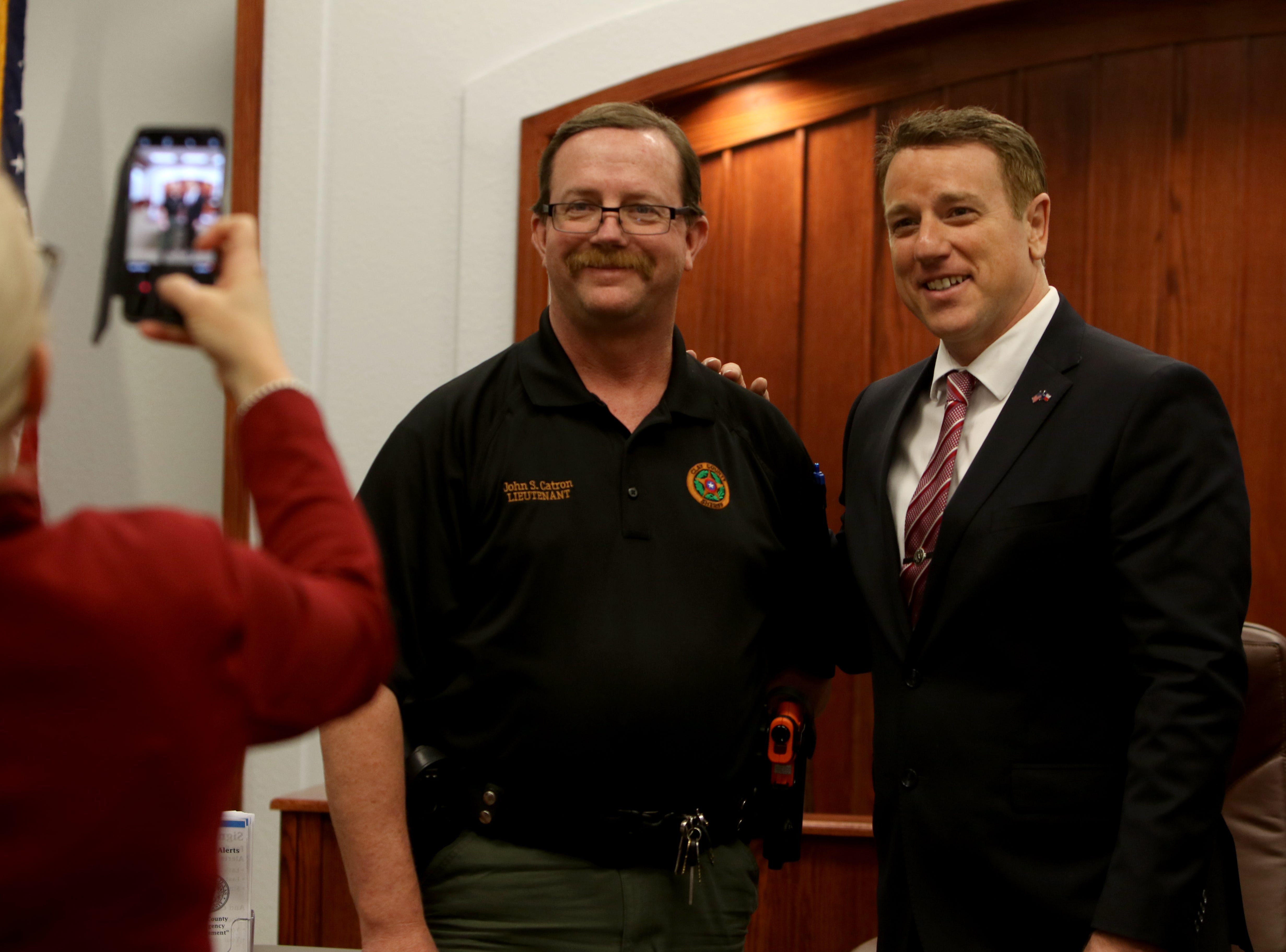 Texas Senator Pat Fallon takes a photo with John Catron after Fallon's town hall Saturday, Feb. 16, 2019, at the Clay County Courthouse Annex in Henrietta.
