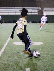 Khalia Jackson passes the ball in Rider's 5-0 victory over Abilene Cooper at Memorial Stadium.