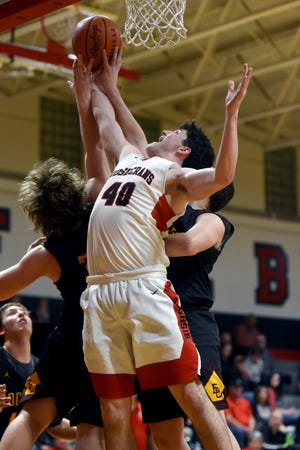 Matt Applegate fights for a rebound during Rosecrans' 59-46 win against Berne Union on Friday night at Rogge Gymnasium. Applegate pulled down a team-high 16 rebounds.