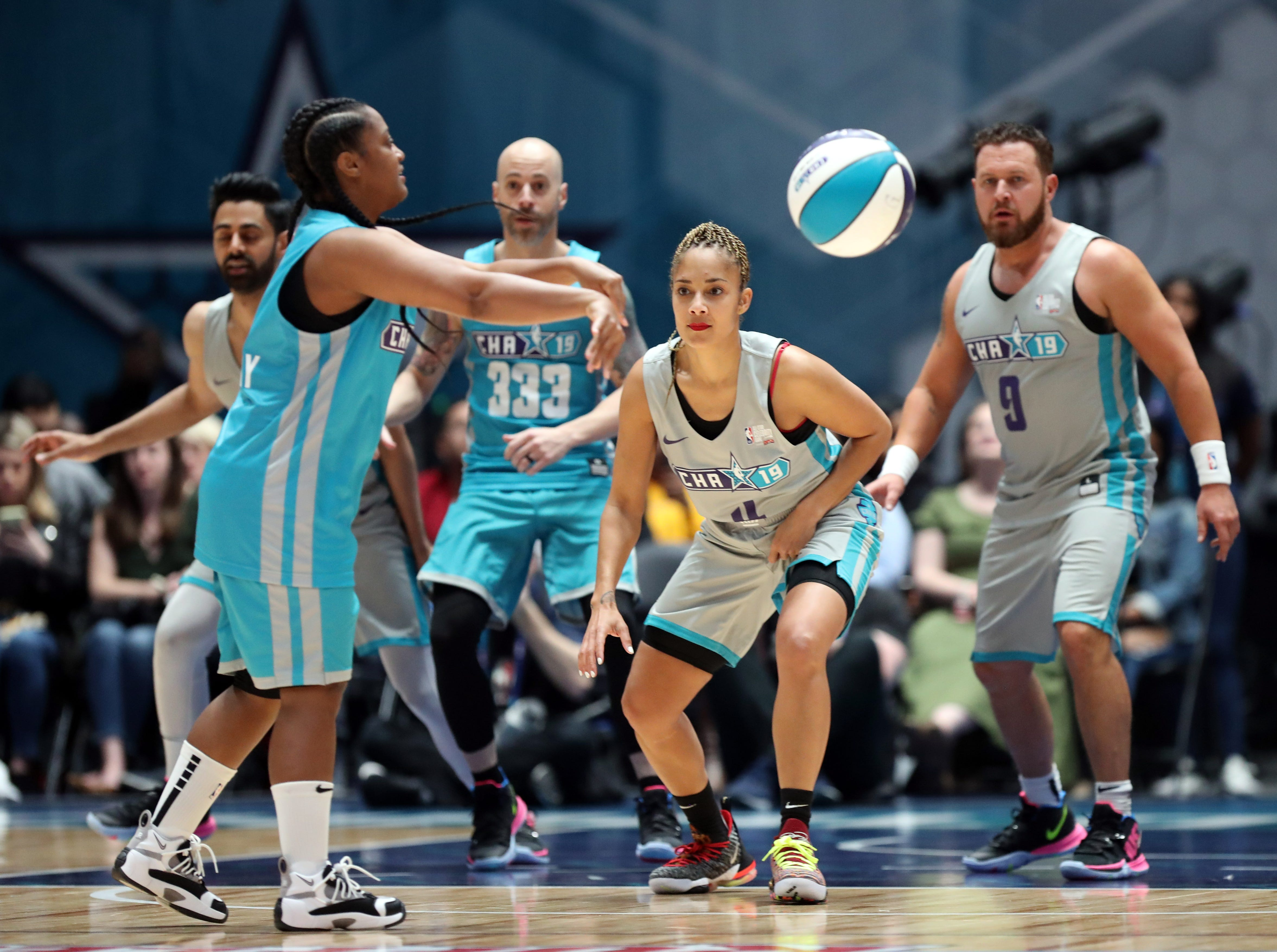 Amanda Seales defends during the second quarter of the Celebrity Game.