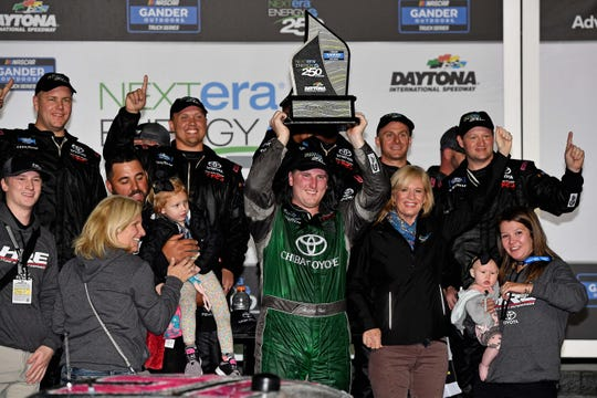 Austin Hill celebrates after winning the NextEra Energy 250 at Daytona International Speedway, the season opener in the NASCAR Gander Outdoors Truck Series.