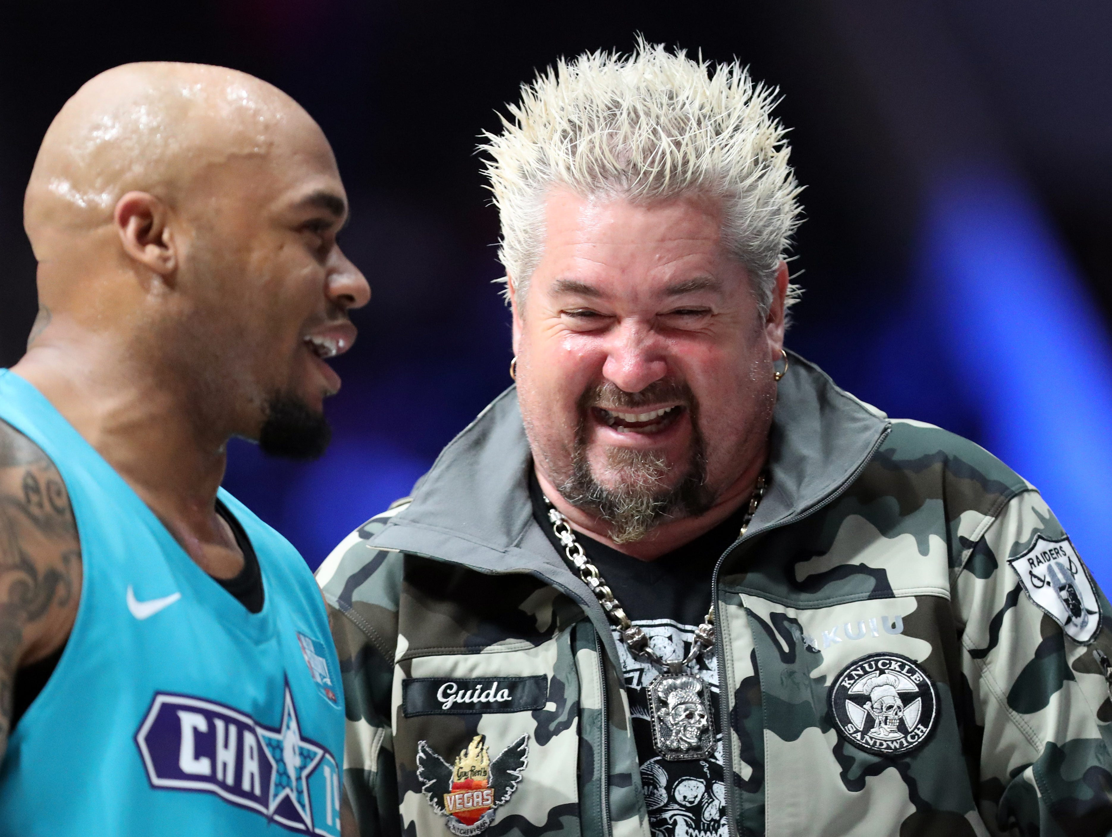 Guy Fieri talks to Steve Smith Sr. after the Celebrity Game.