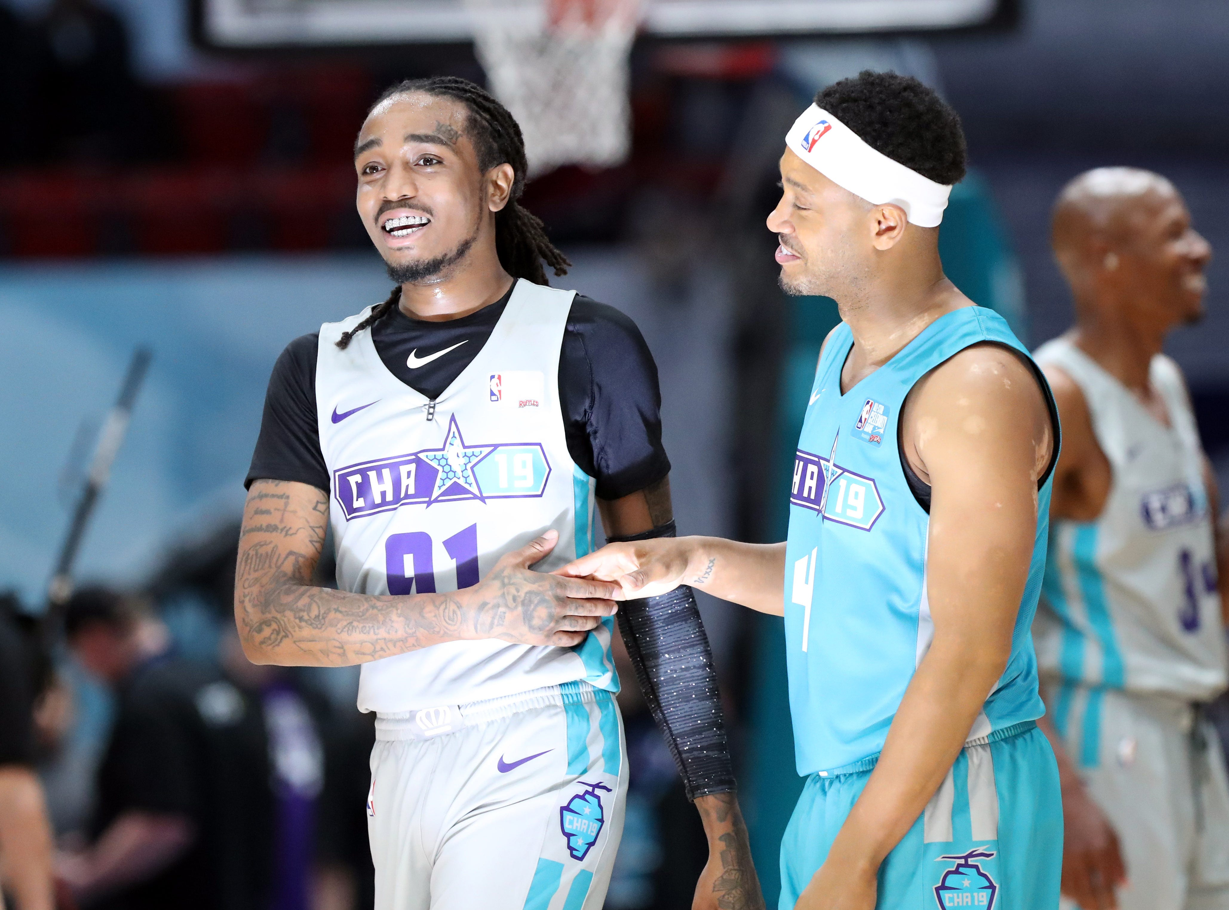 Quavo and Terrence J shake hands during the Celebrity Game.