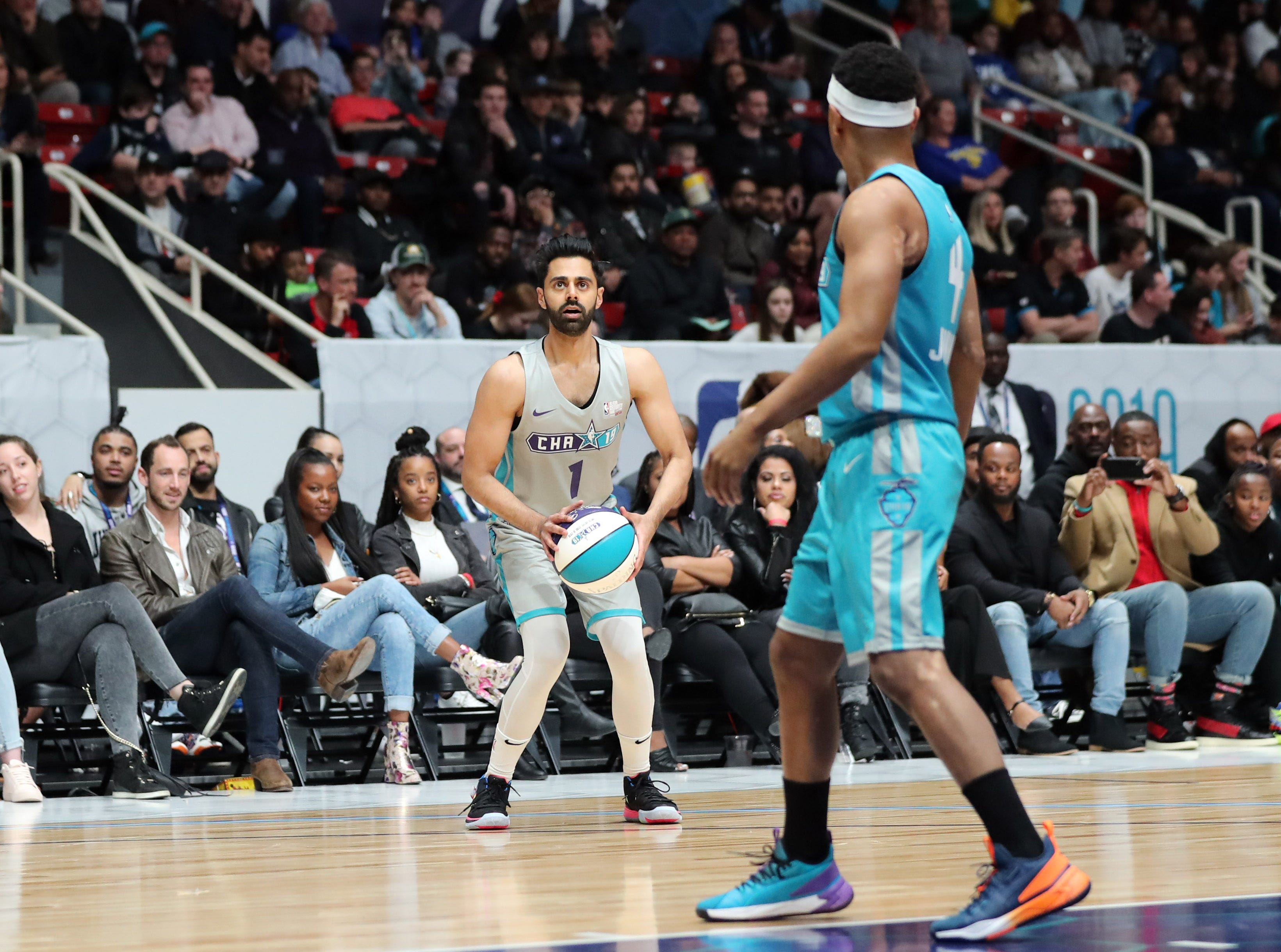 Hasan Minhaj takes a shot during the second quarter of the Celebrity Game.