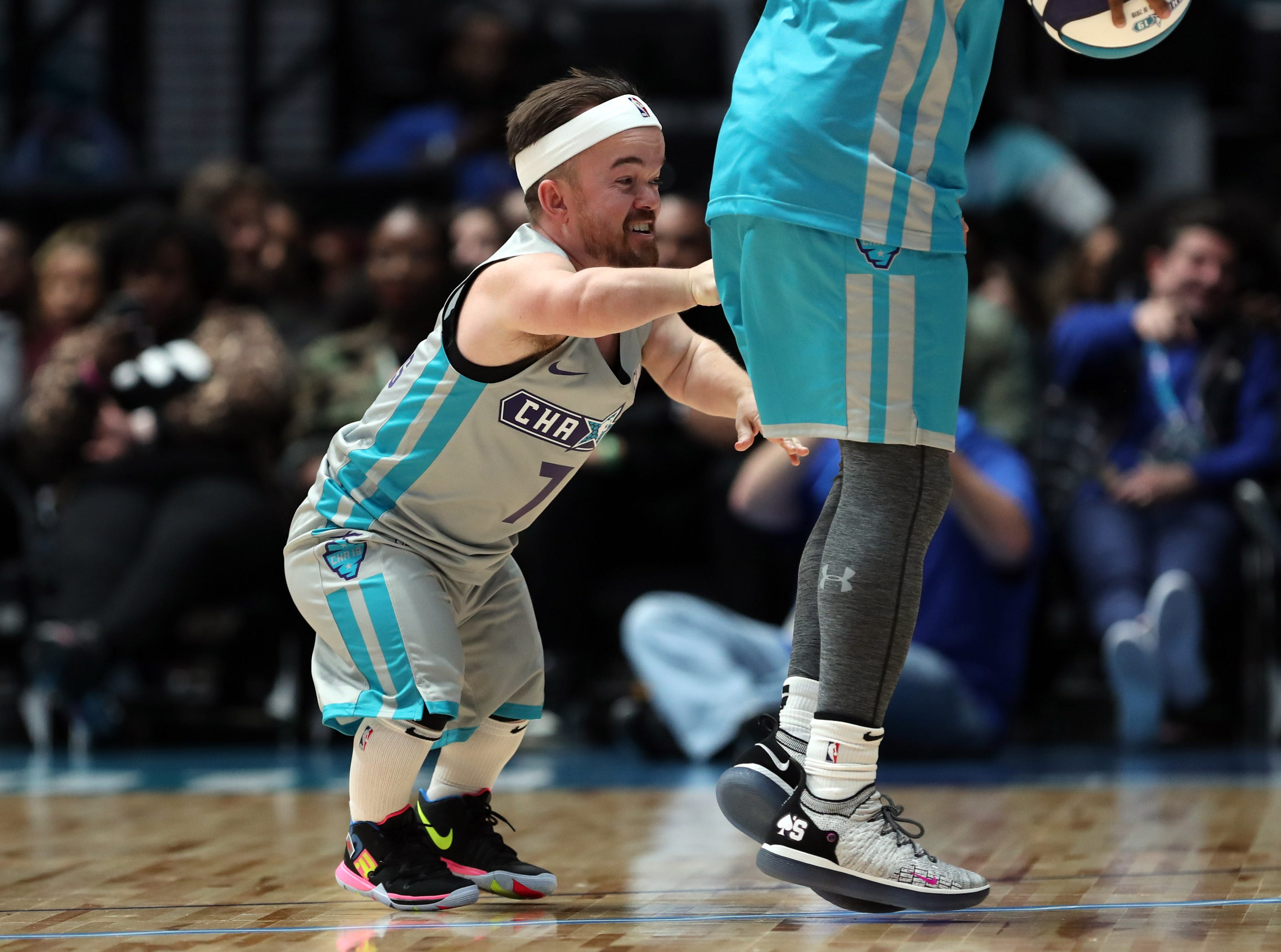 Brad Williams plays defense during the Celebrity Game.