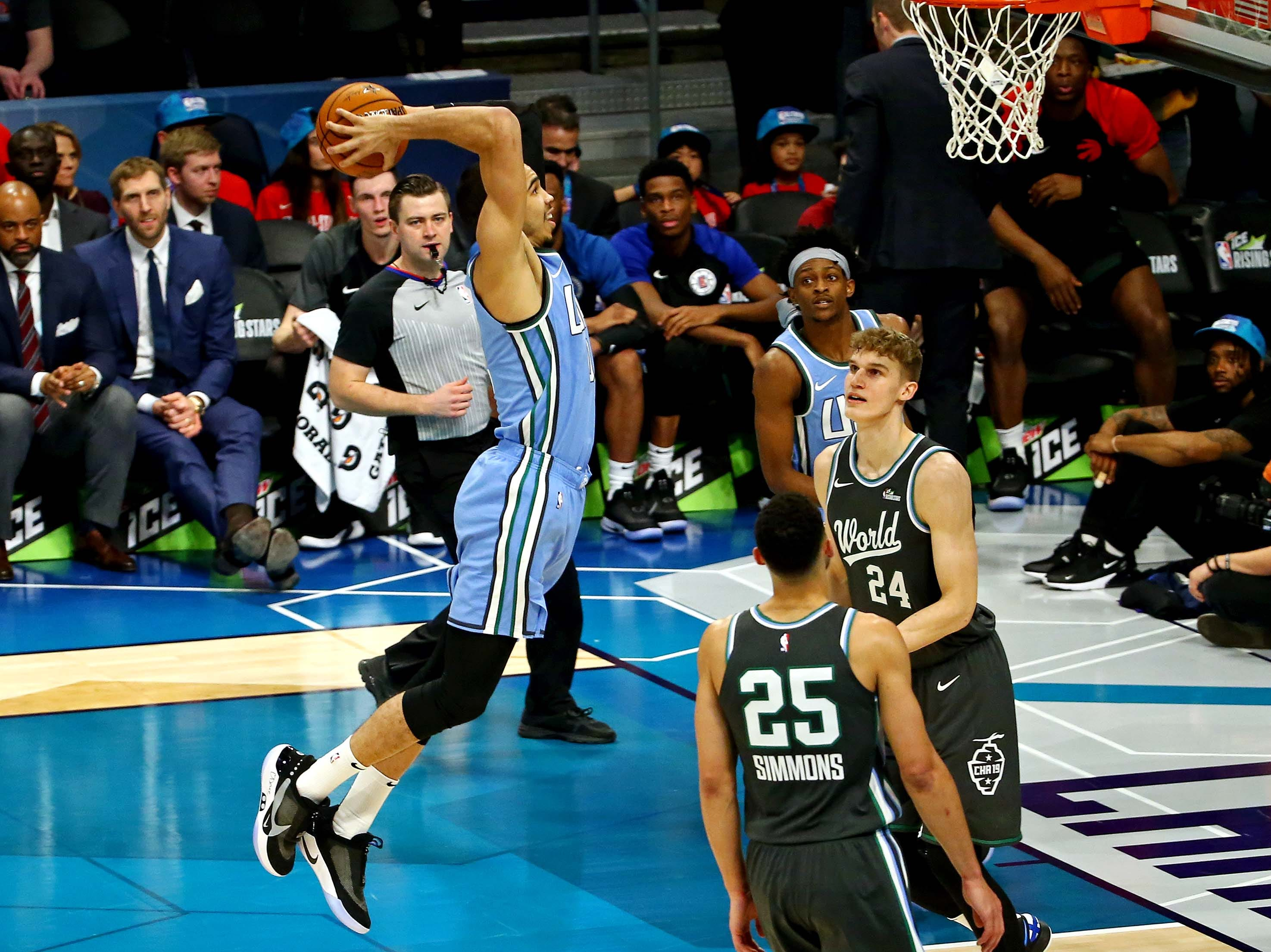 U.S. Team forward Jayson Tatum of the Boston Celtics dunks the ball during the All-Star Rising Stars game.