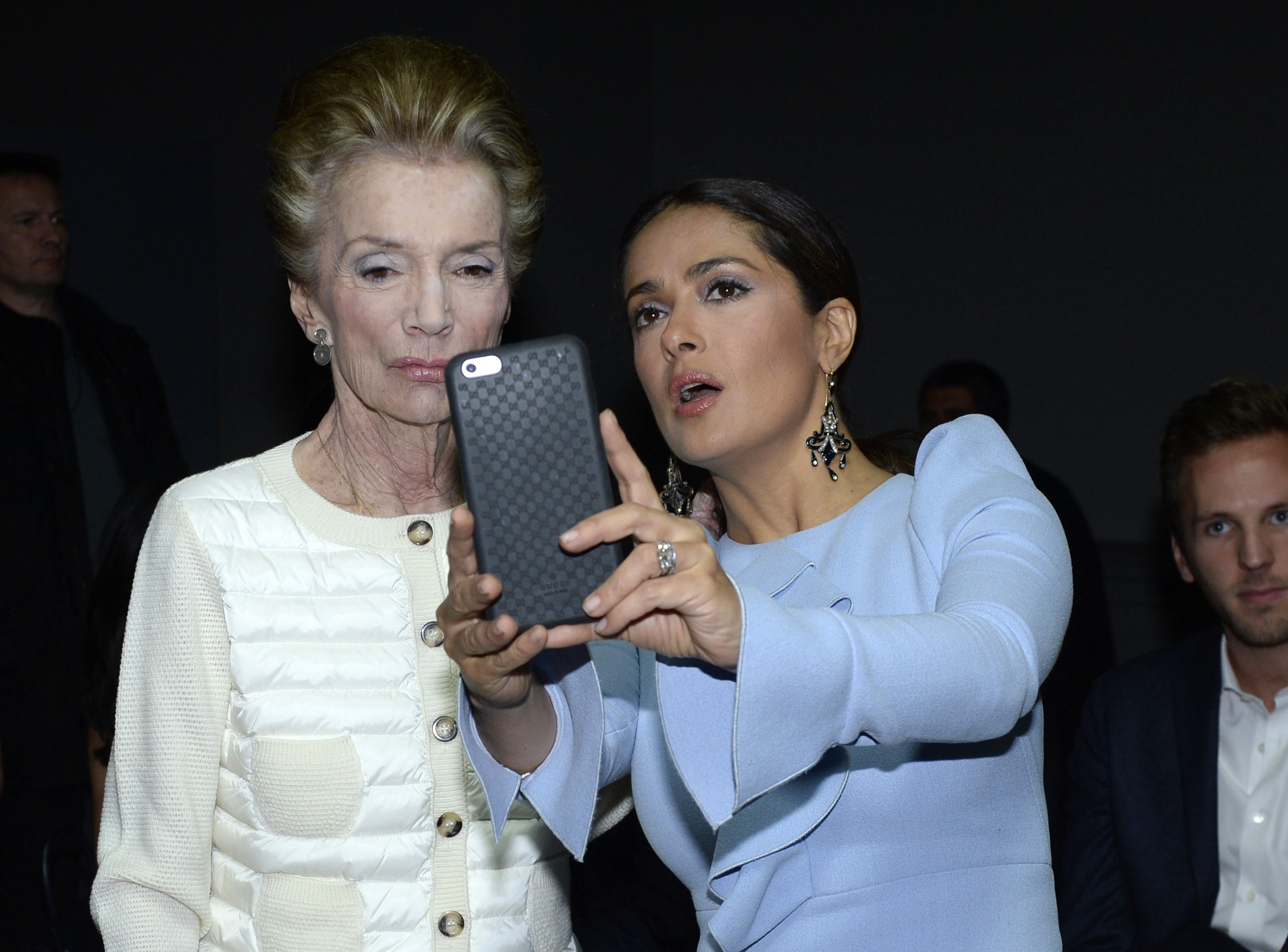 Princess Lee Radziwill and Mexican actress Salma Hayek pose for a selfie before the Giambattista Valli 2016 Spring/Summer ready-to-wear collection fashion show, on Oct. 5, 2015 in Paris.