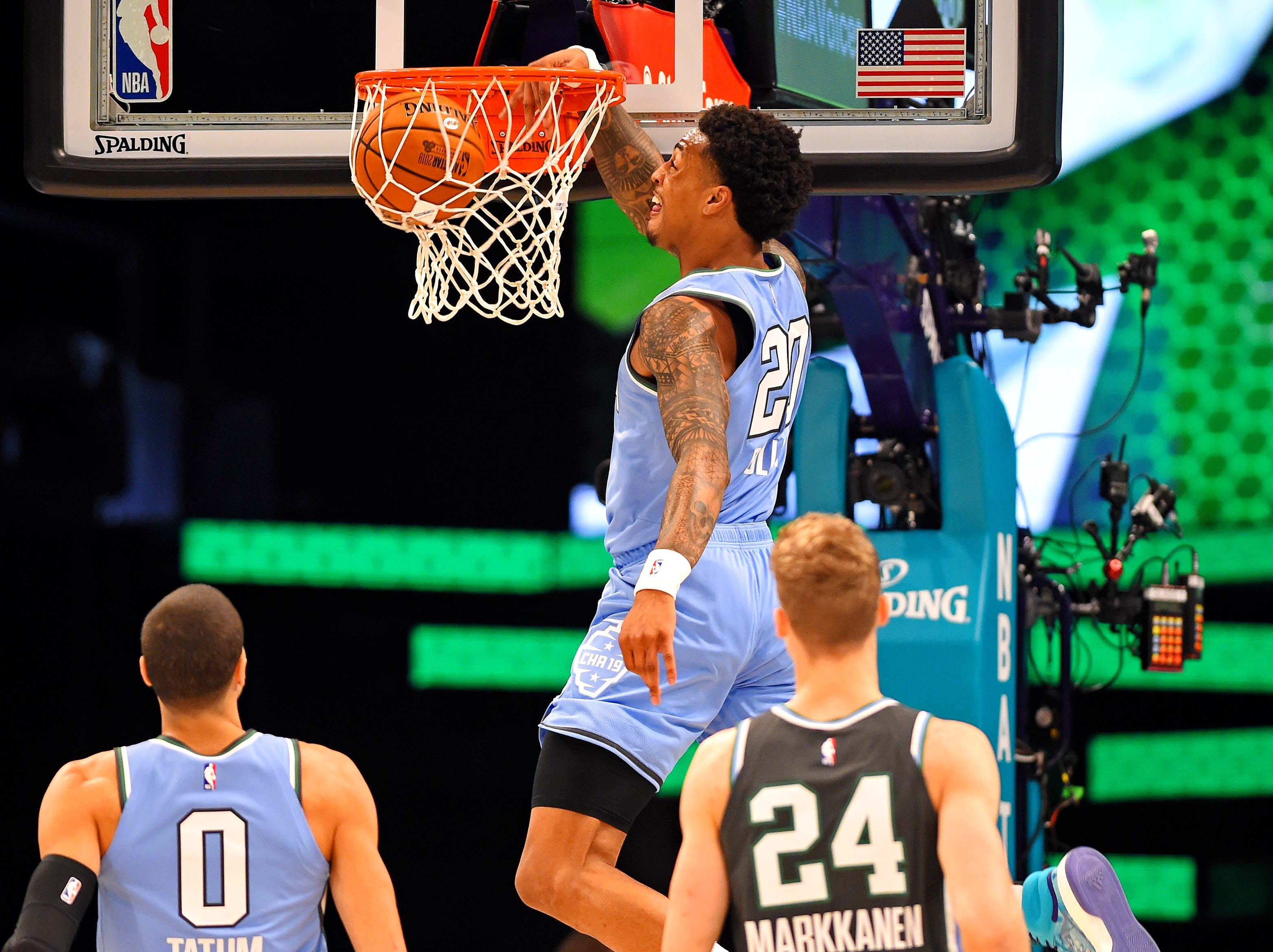 John Collins of the Atlanta Hawks dunks the ball against the World Team during the All-Star Rising Stars game.