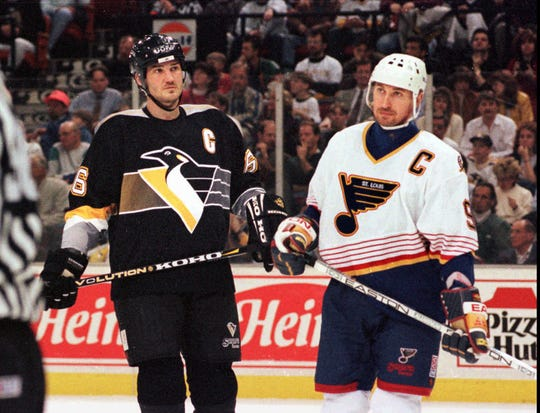 Mario Lemieux, left, and Wayne Gretzky during an NHL game in Pittsburgh in 1996.