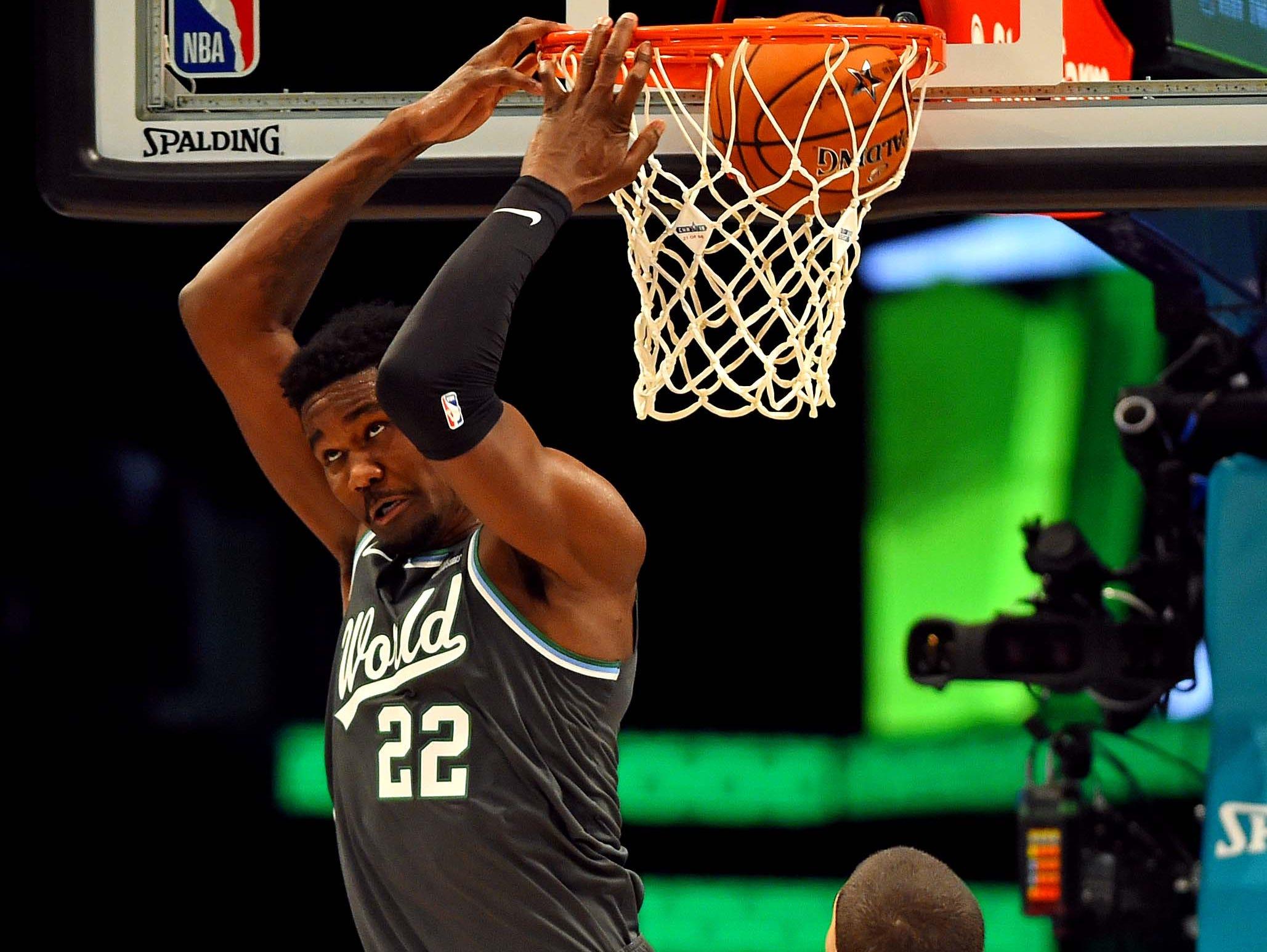 World Team center Deandre Ayton of the Phoenix Suns dunks the ball during the All-Star Rising Stars game.