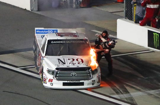 Natalie Decker is pulled from her fiery truck after being involved in a crash during the NextEra Energy 250.