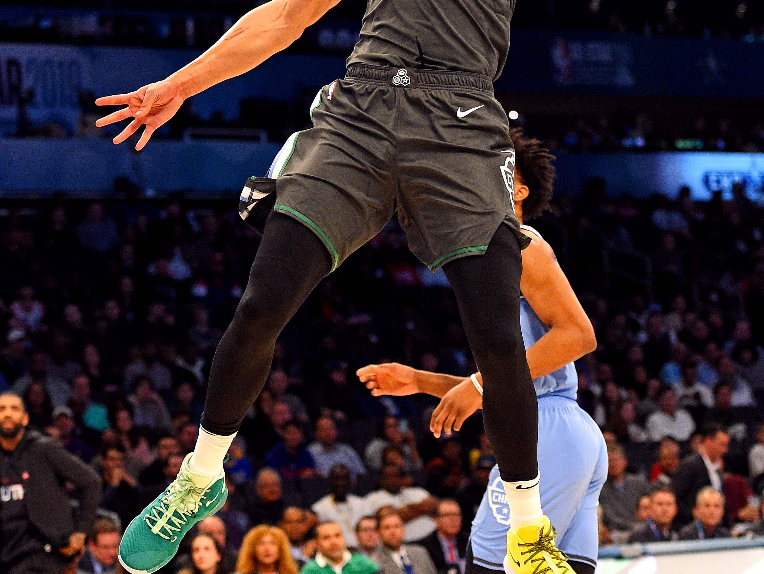 Ben Simmons dunks during the All-Star Rising Stars game.