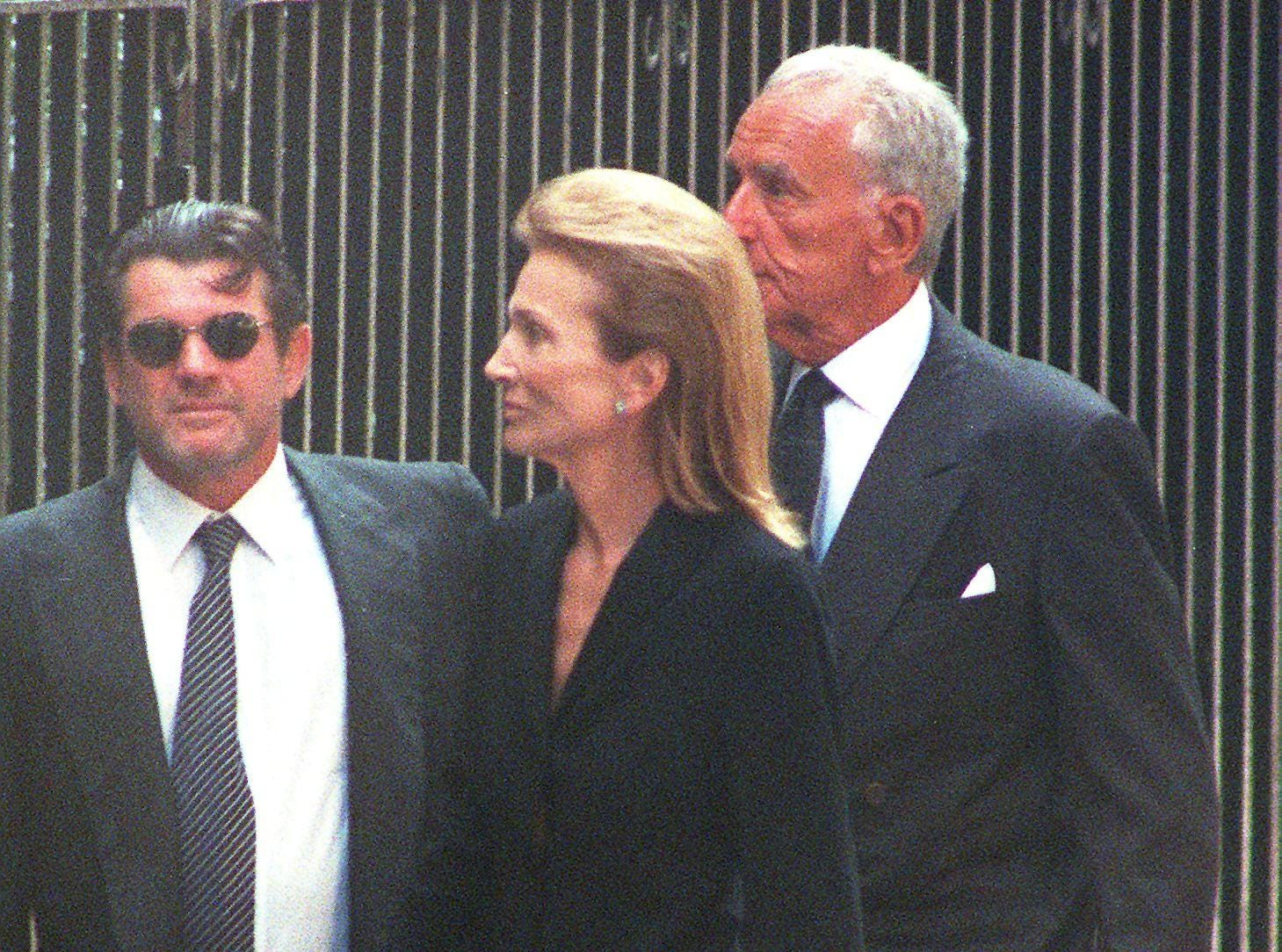 Lee Radziwill, the sister of Jacqueline Kennedy Onassis, arrives at the Church of St. Thomas More for a memorial service for John F. Kennedy Jr. and his wife, Carolyn Bessette Kennedy, who were killed in a plane crash off the coast of Martha's Vineyard nearly a week ago.  Also arriving is Jann Wenner, left, the publisher of Rolling Stone Magazine, who was a friend of Kennedy Jr.'s.