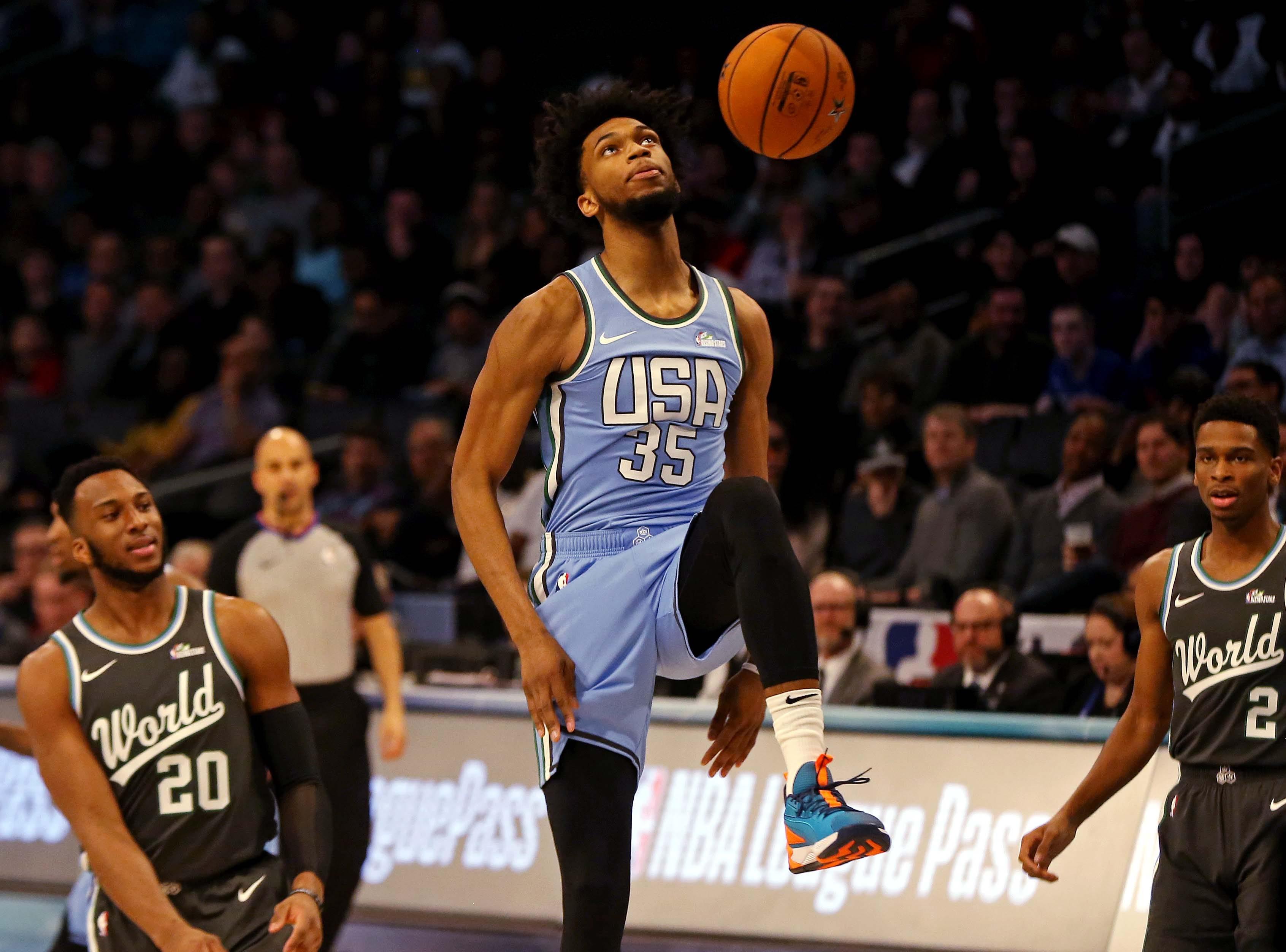 U.S. Team forward Marvin Bagley III of the Sacramento Kings dunks the ball against the World Team.