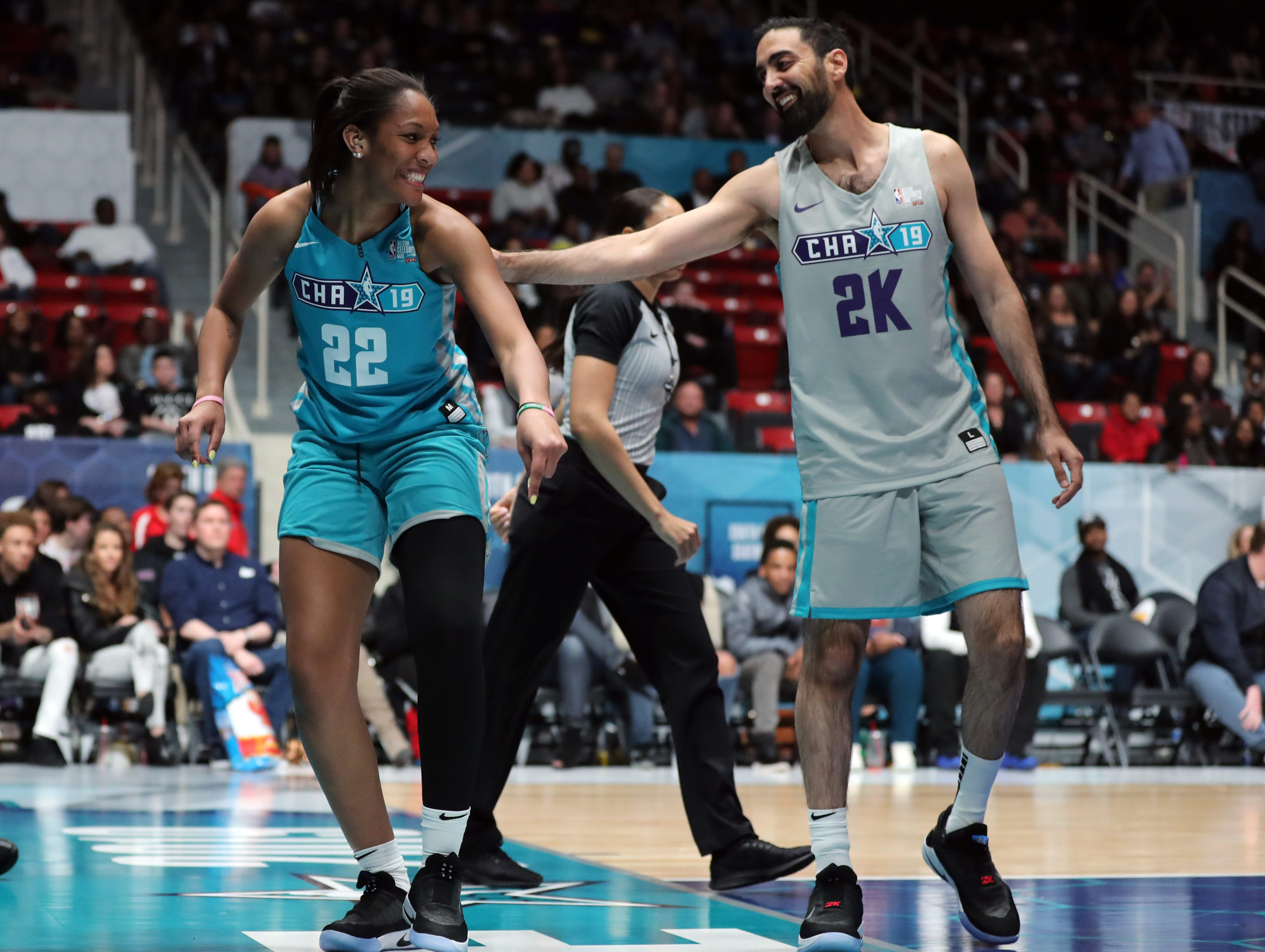 A'ja Wilson is fouled by Ronnie 2K during the third quarter of the Celebrity Game.