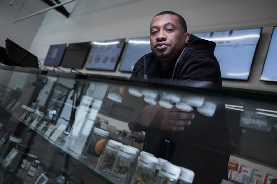 "Alphonso ""Tucky"" Blunt, 39, is photographed at his marijuana dispensary, Blunts and Moore in Oakland, Calif."