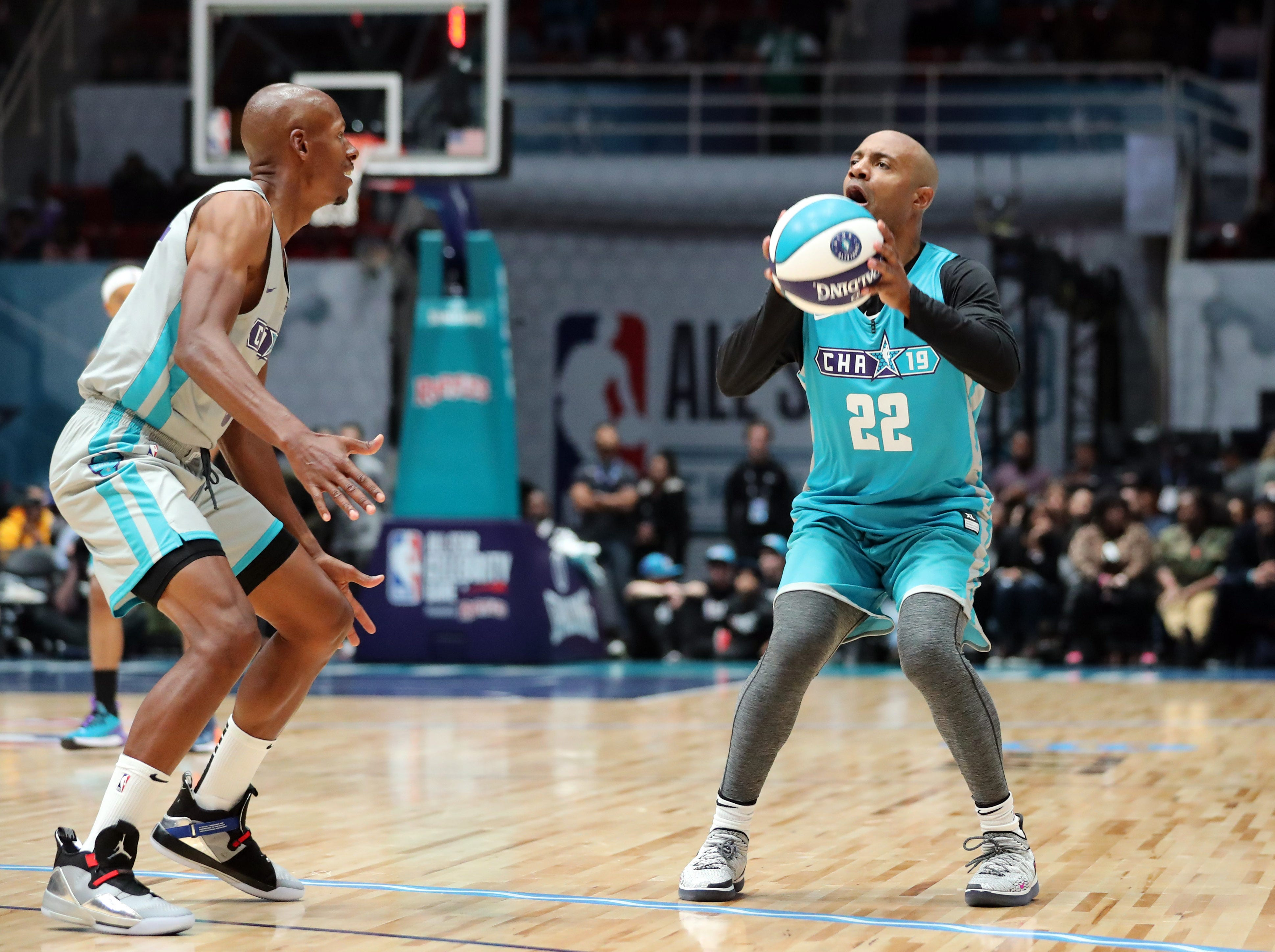 Jay Williams takes a shot while defended by Ray Allen during the third quarter of the Celebrity Game.