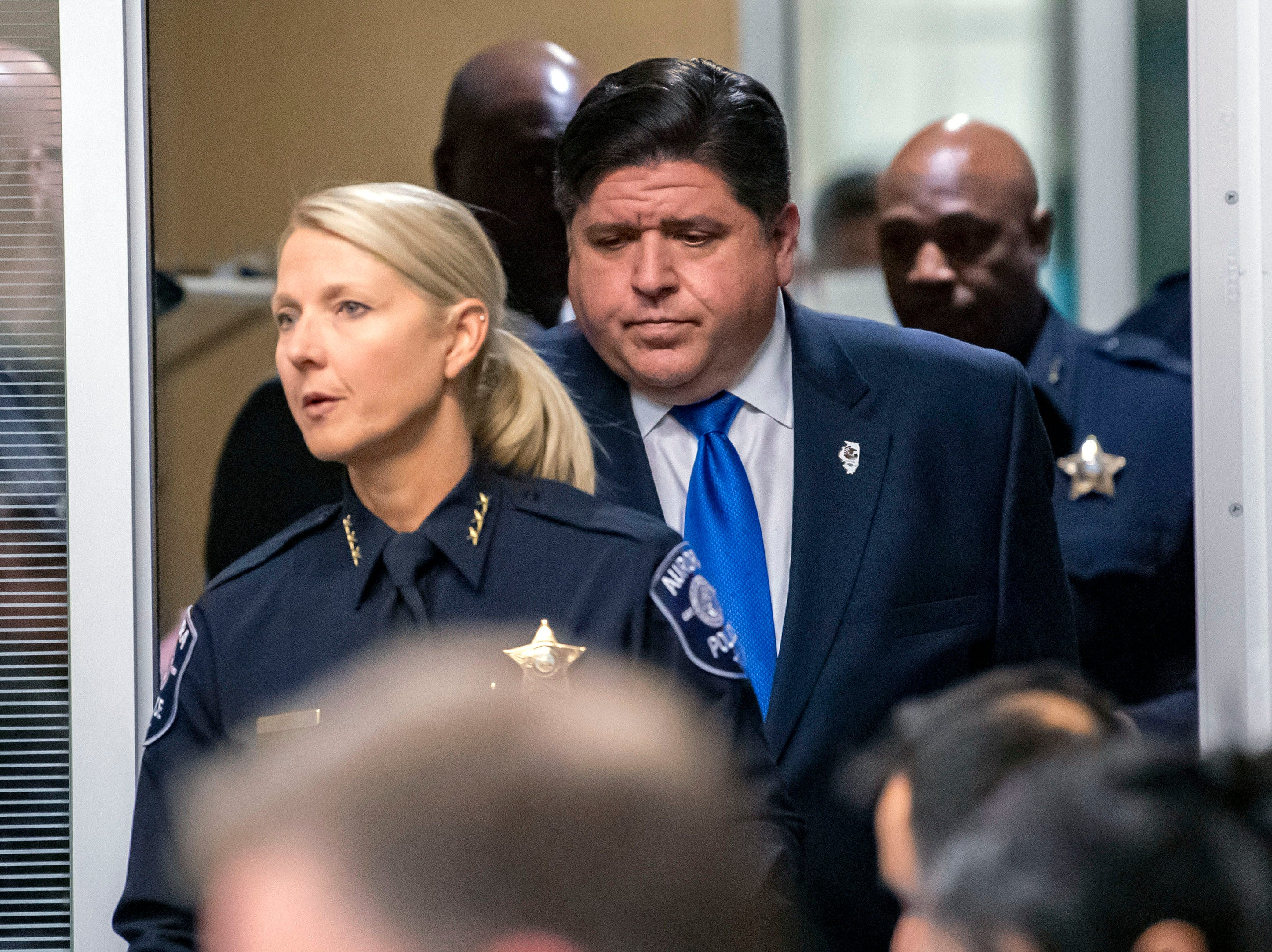 Aurora Police Chief Kristen Ziman escorts Illinois Governor J. B. Pritzker into a press conference at the Aurora Police Headquarters, after an active shooter was neutralized at the Henry Pratt Company.