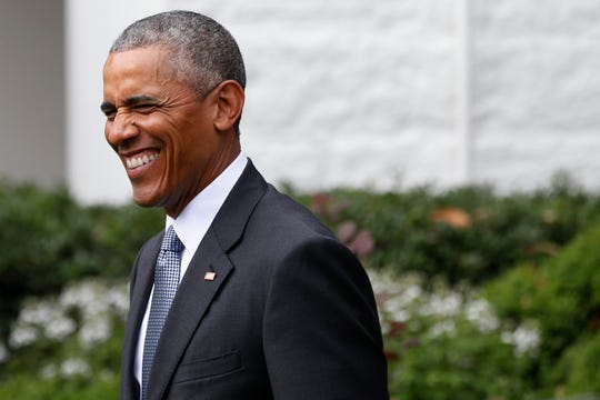 Barack Obama walks into the Rose Garden during a ceremony honoring the Super Bowl champion Denver Broncos.