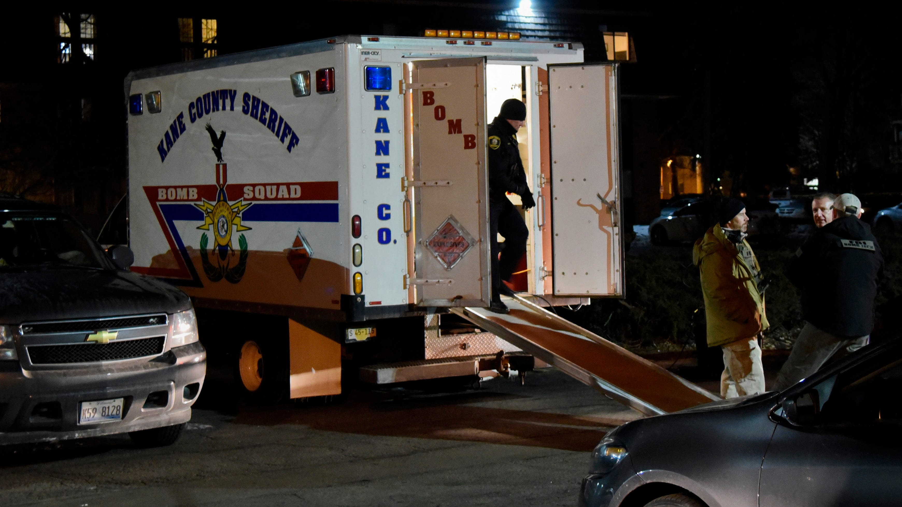 Investigators work at the apartment complex of the alleged shooter from the Henry Pratt Co. in Aurora, Illinois.