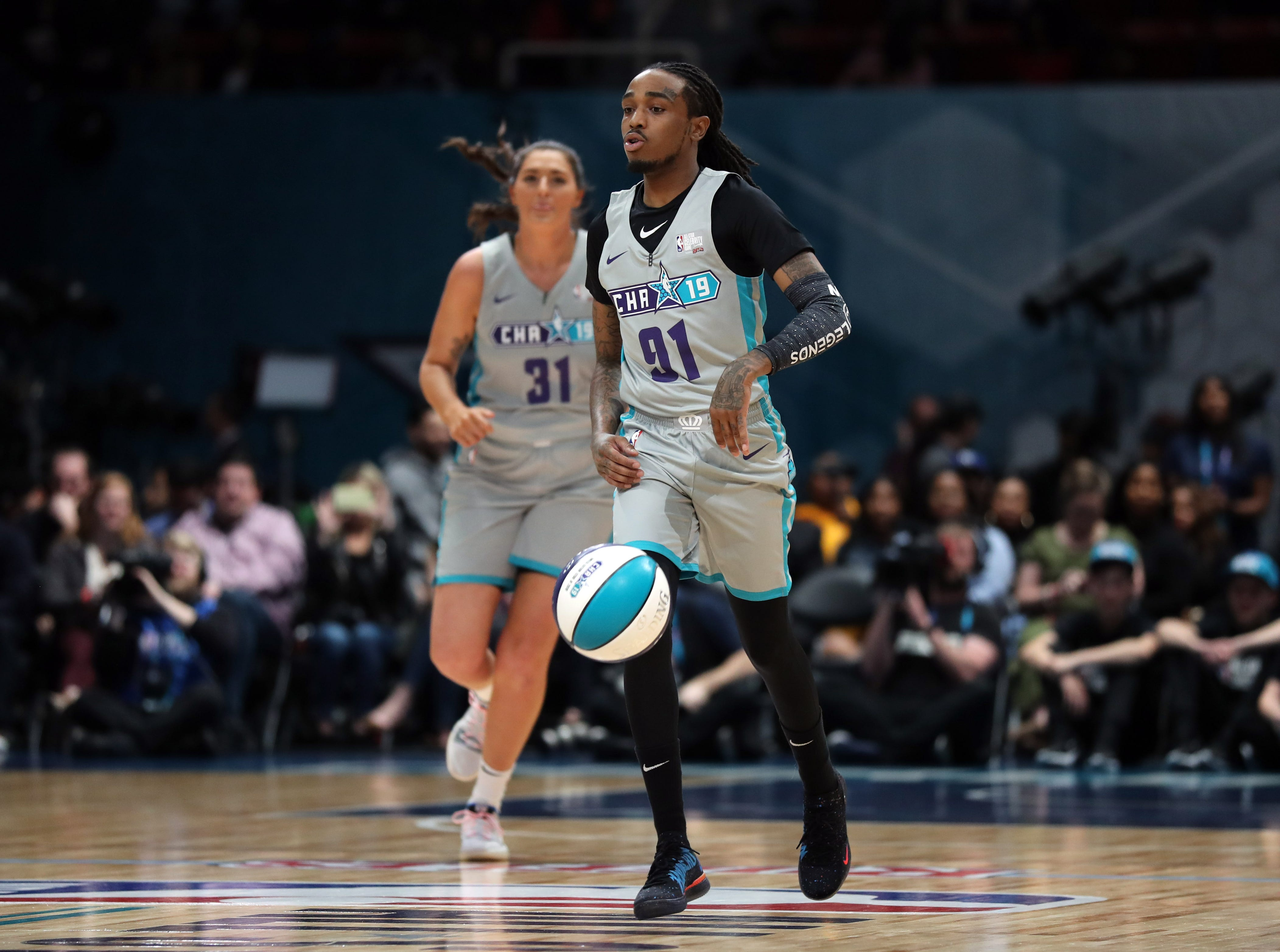 Quavo brings the ball up the court during the first quarter of the Celebrity Game.