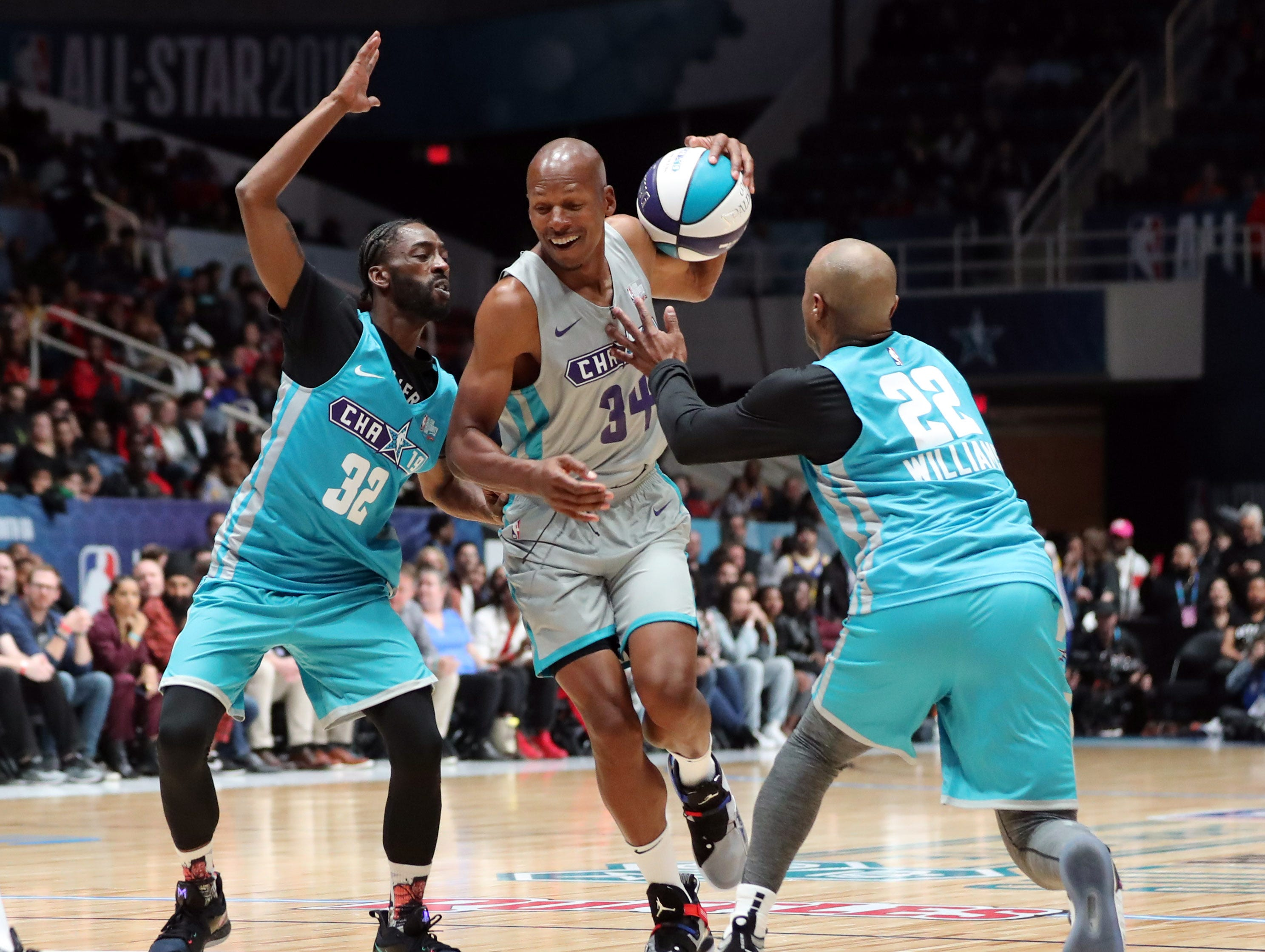 Ray Allen is guarded by Famous Los and Jay Williams during the Celebrity Game.