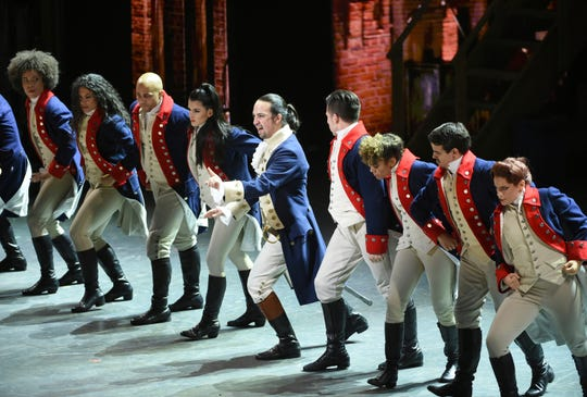 "In this June 12, 2016 file photo, Lin-Manuel Miranda, center, and the cast of ""Hamilton"" perform at the Tony Awards in New York."