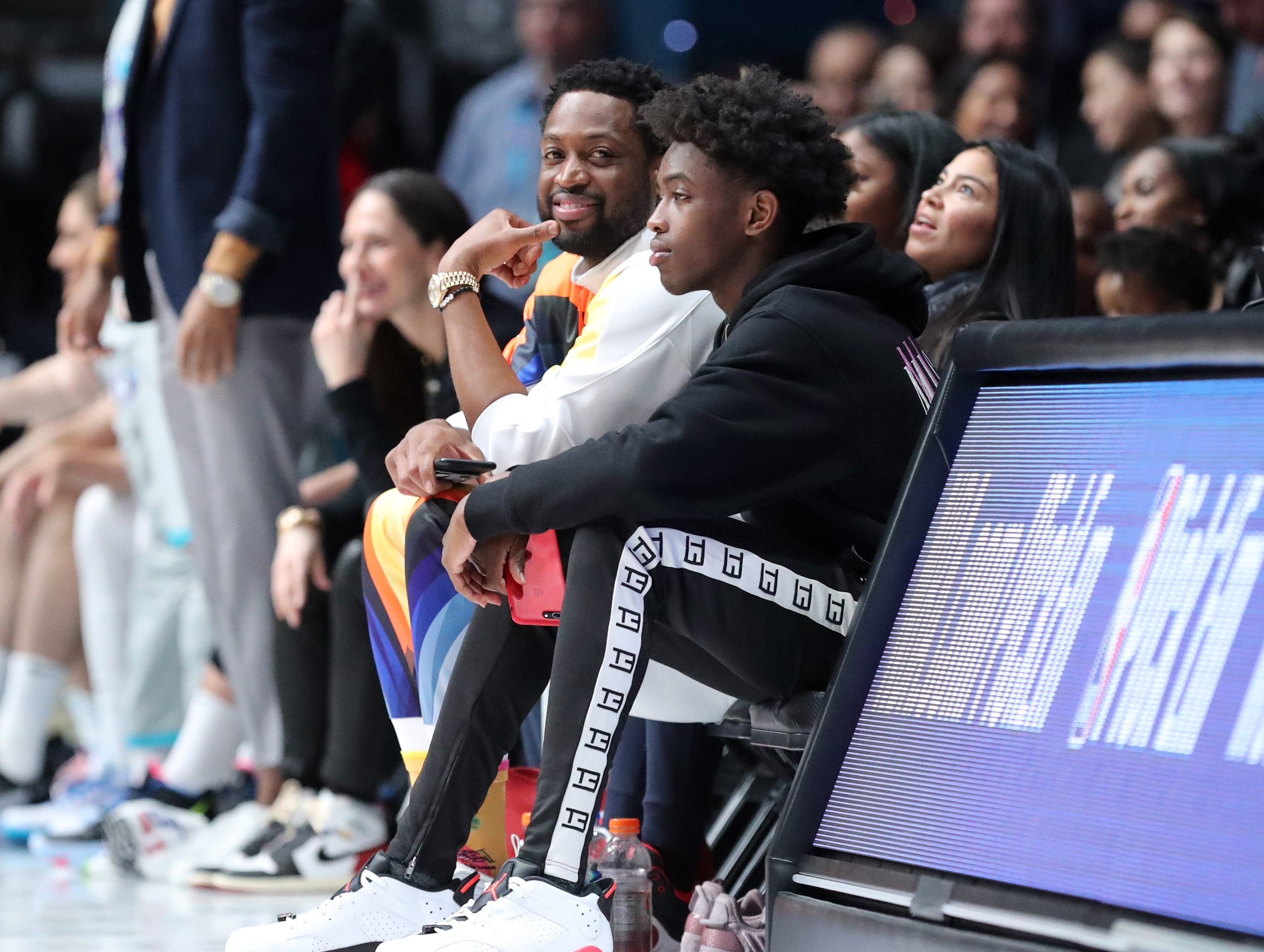 Miami Heat guard Dwyane Wade sits on the sidelines of the Celebrity Game.