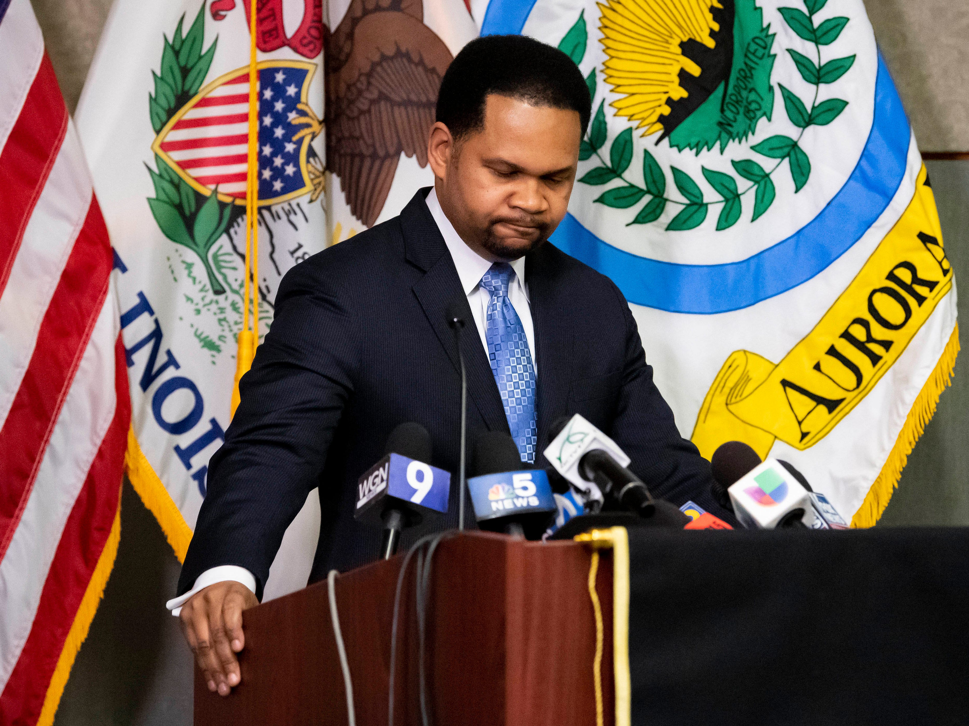 Aurora Mayor Richard C. Irvin reacts during a press conference at the Aurora Police Headquarters, after an active shooter was neutralized at the Henry Pratt Company.