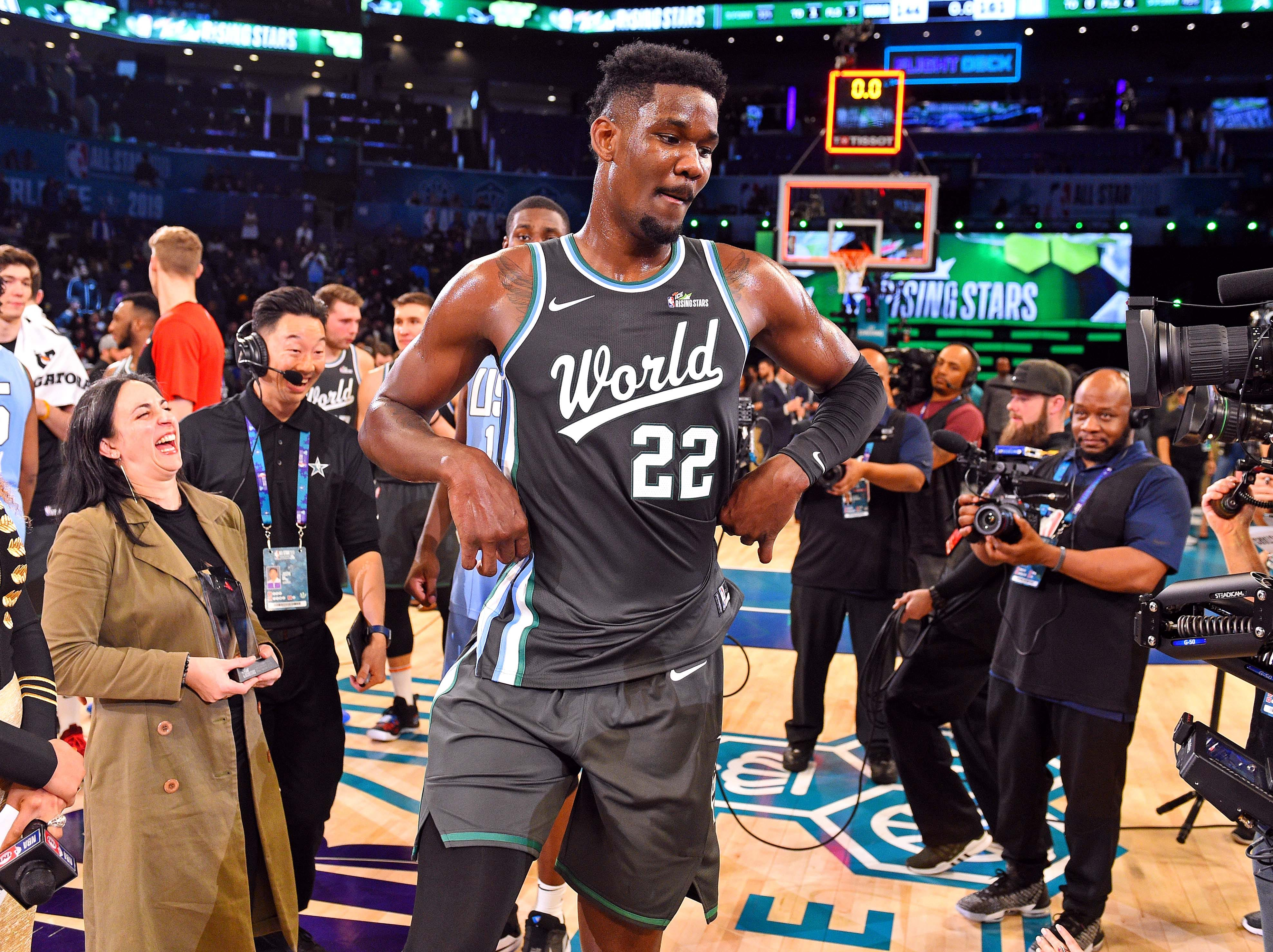 World Team center Deandre Ayton of the Phoenix Suns dances after the All-Star Rising Stars game.